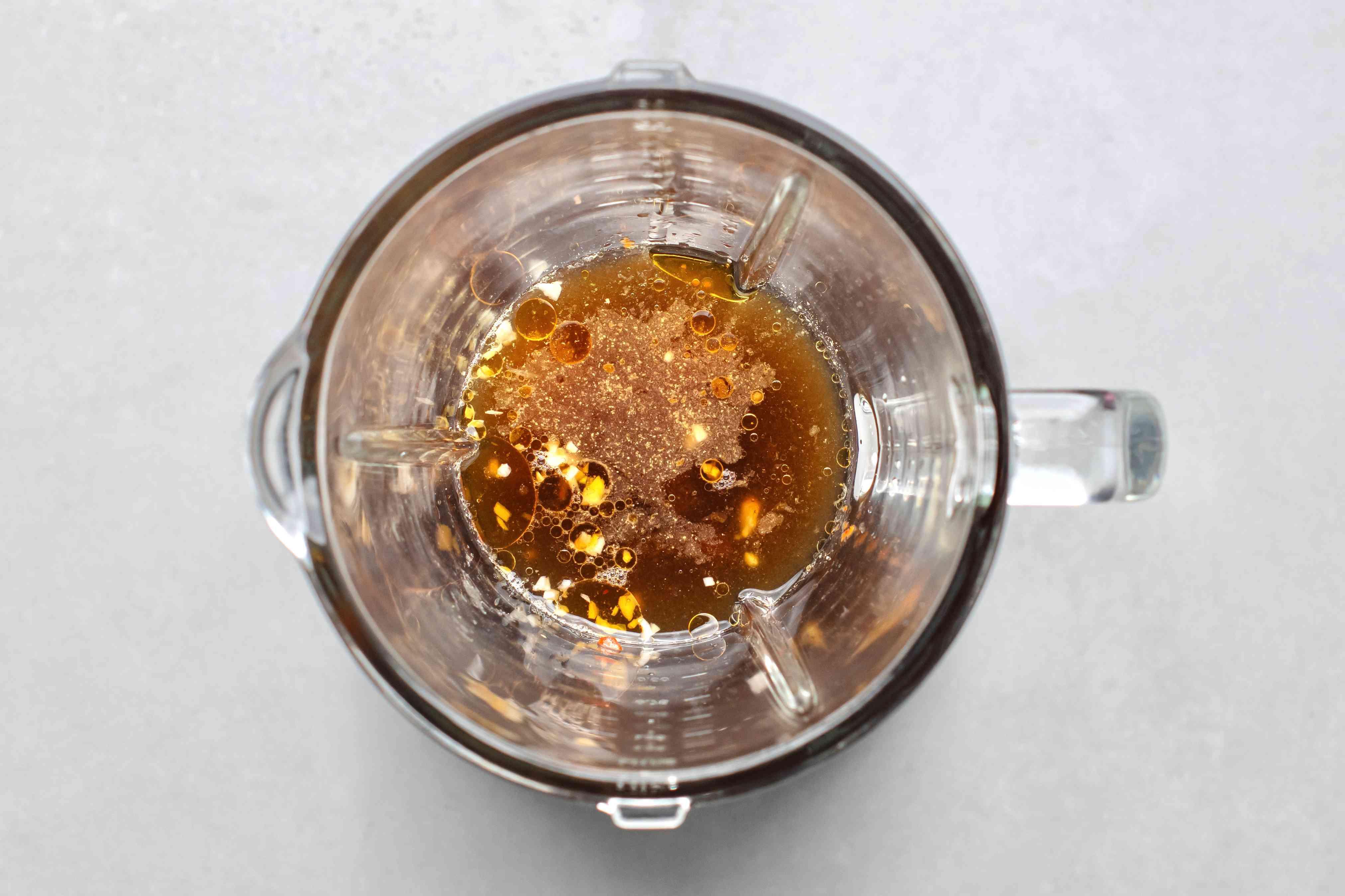 vegetable broth, rice vinegar, soy sauce, sesame oil, sugar, garlic, ginger, chili paste and lime in a blender