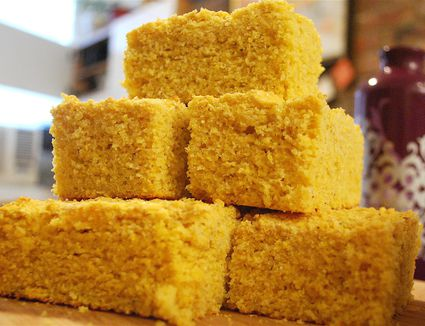 Buttermilk corn bread cut into squares and stacked