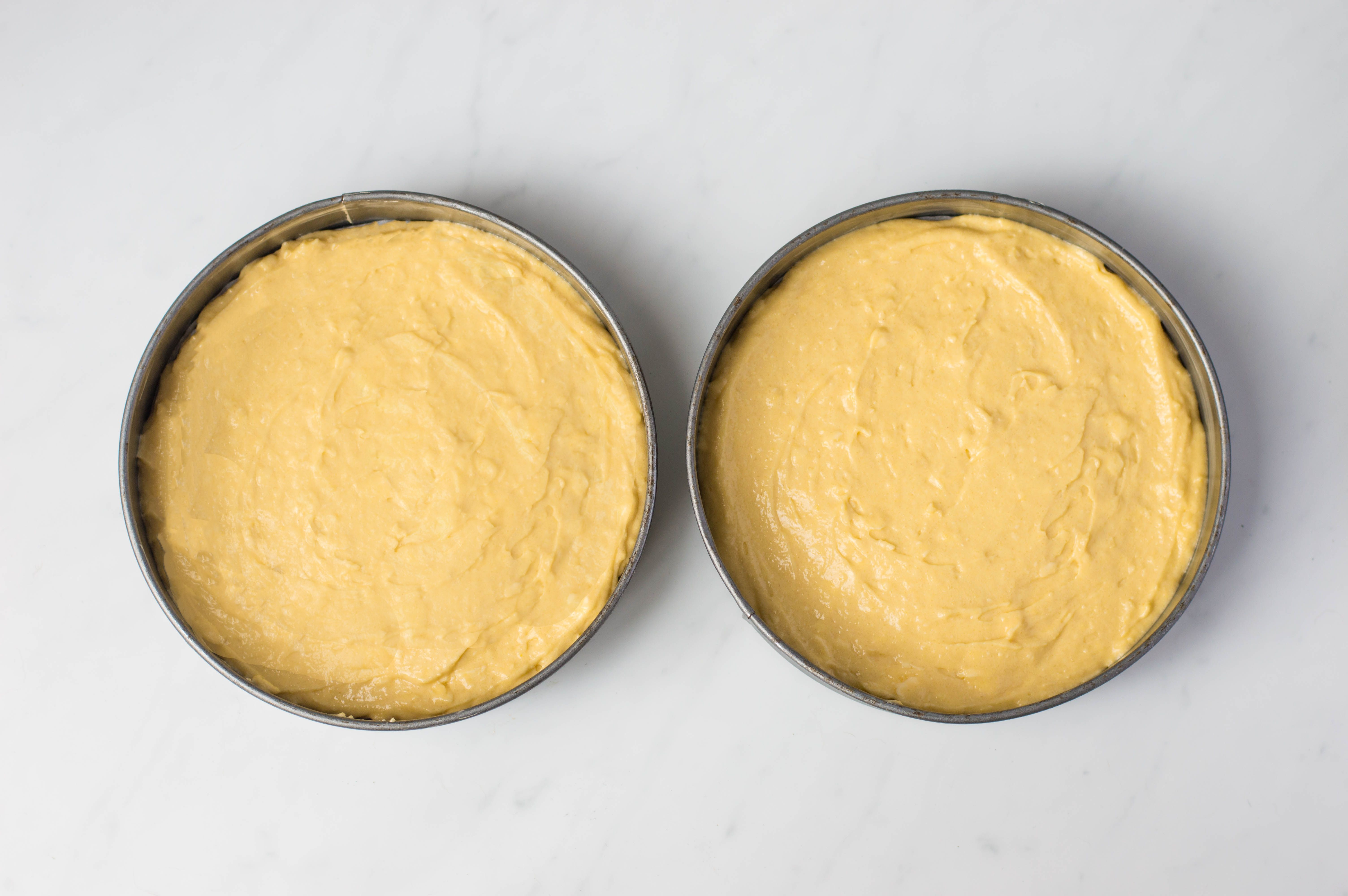 Batter evenly separated into two cake pans