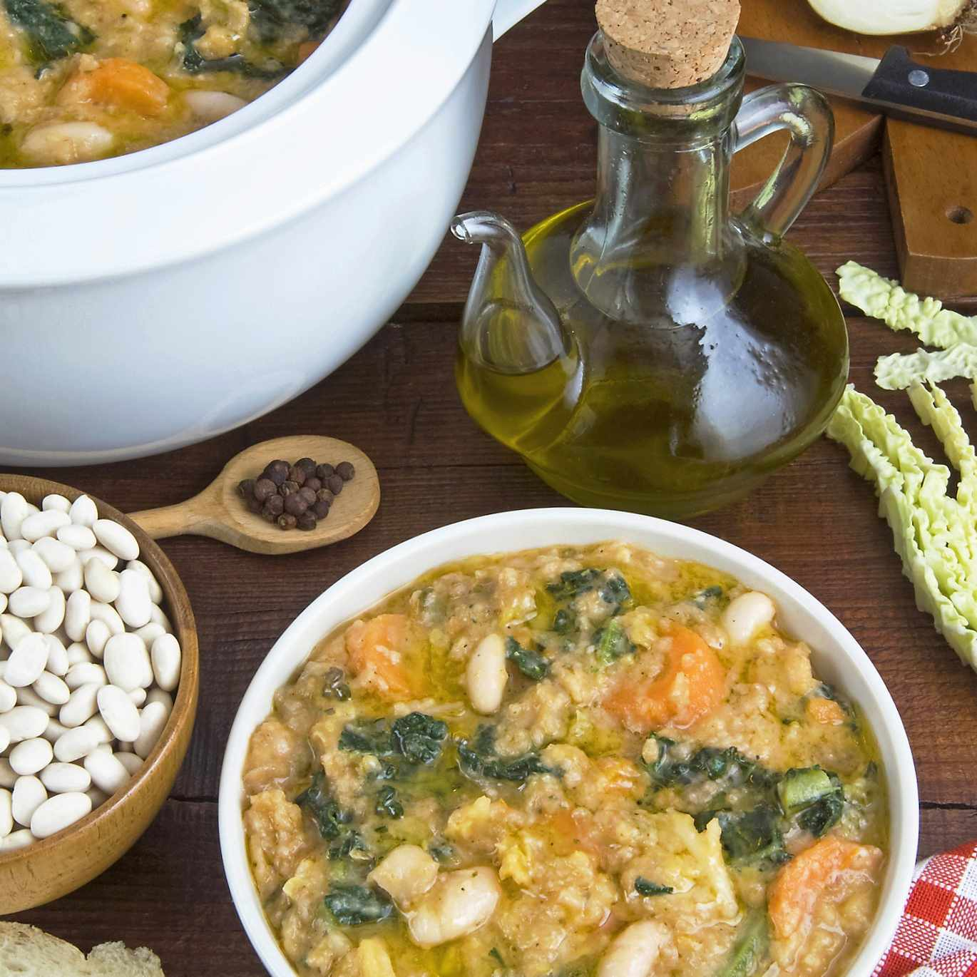 Tuscan Ribollita soup (Florentine soup) made with lacinato kale, cannellini beans, Tuscan bread, and olive oil