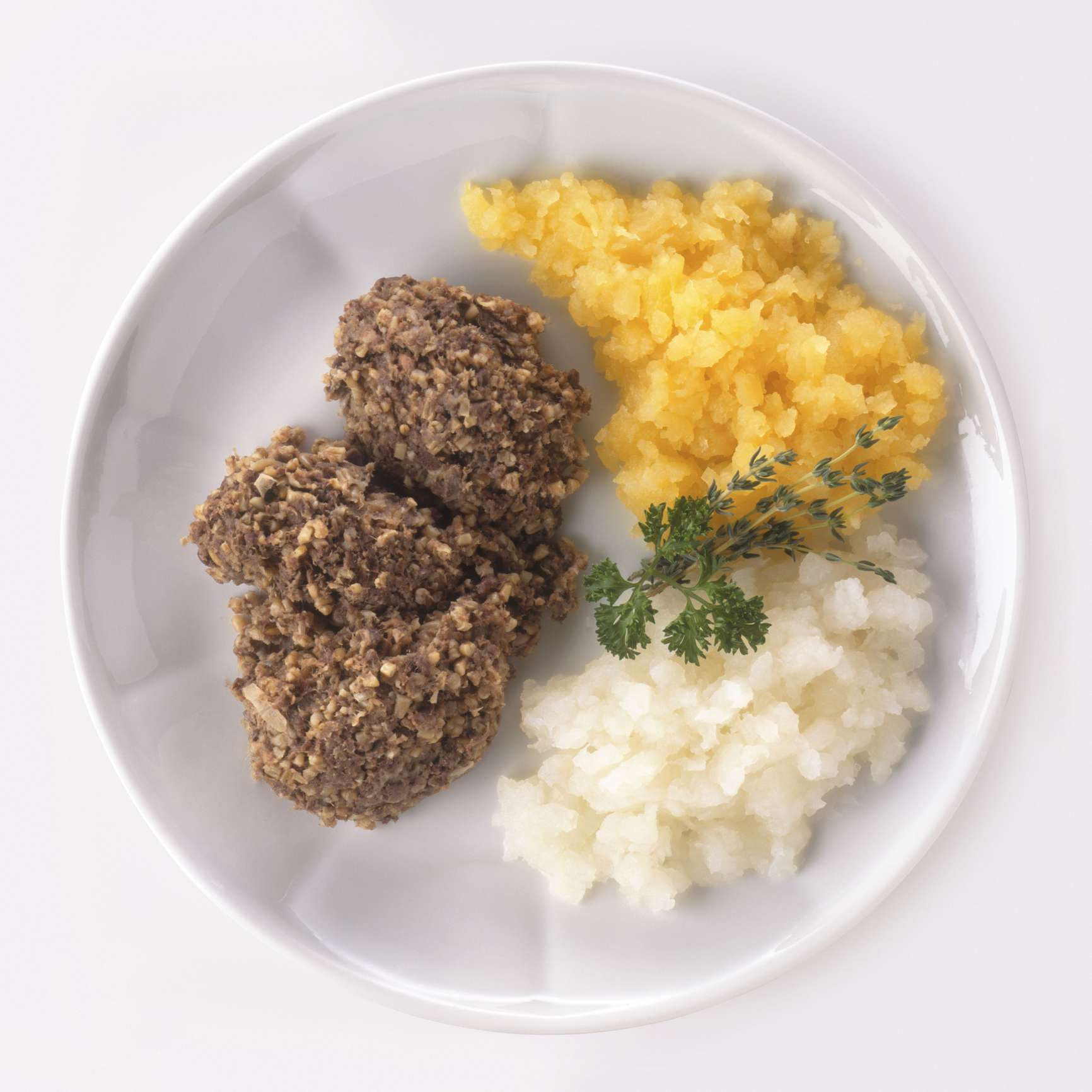Haggis is a traditional Scottish dish often served with mash potatoes