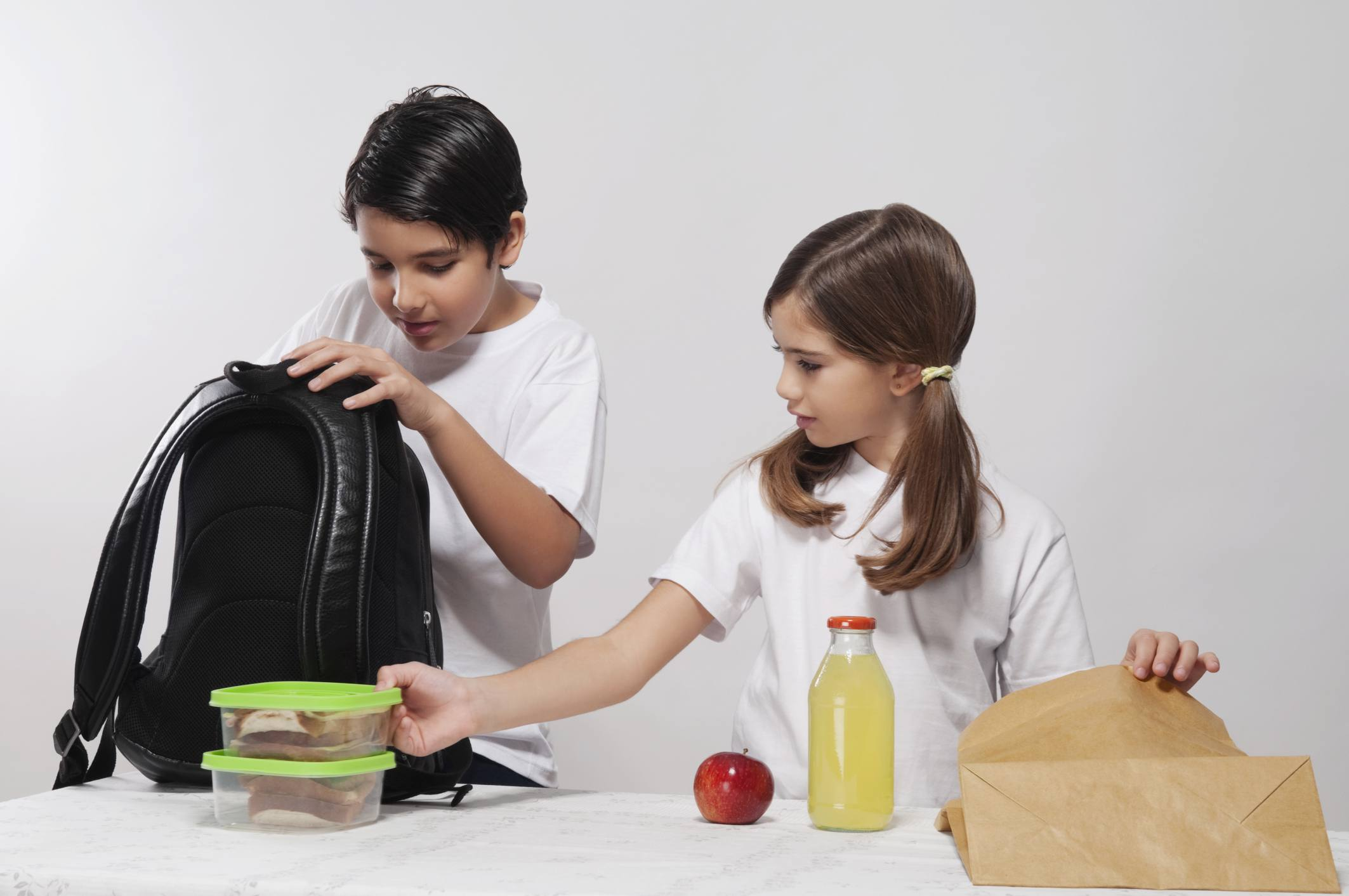 Kids packing lunches