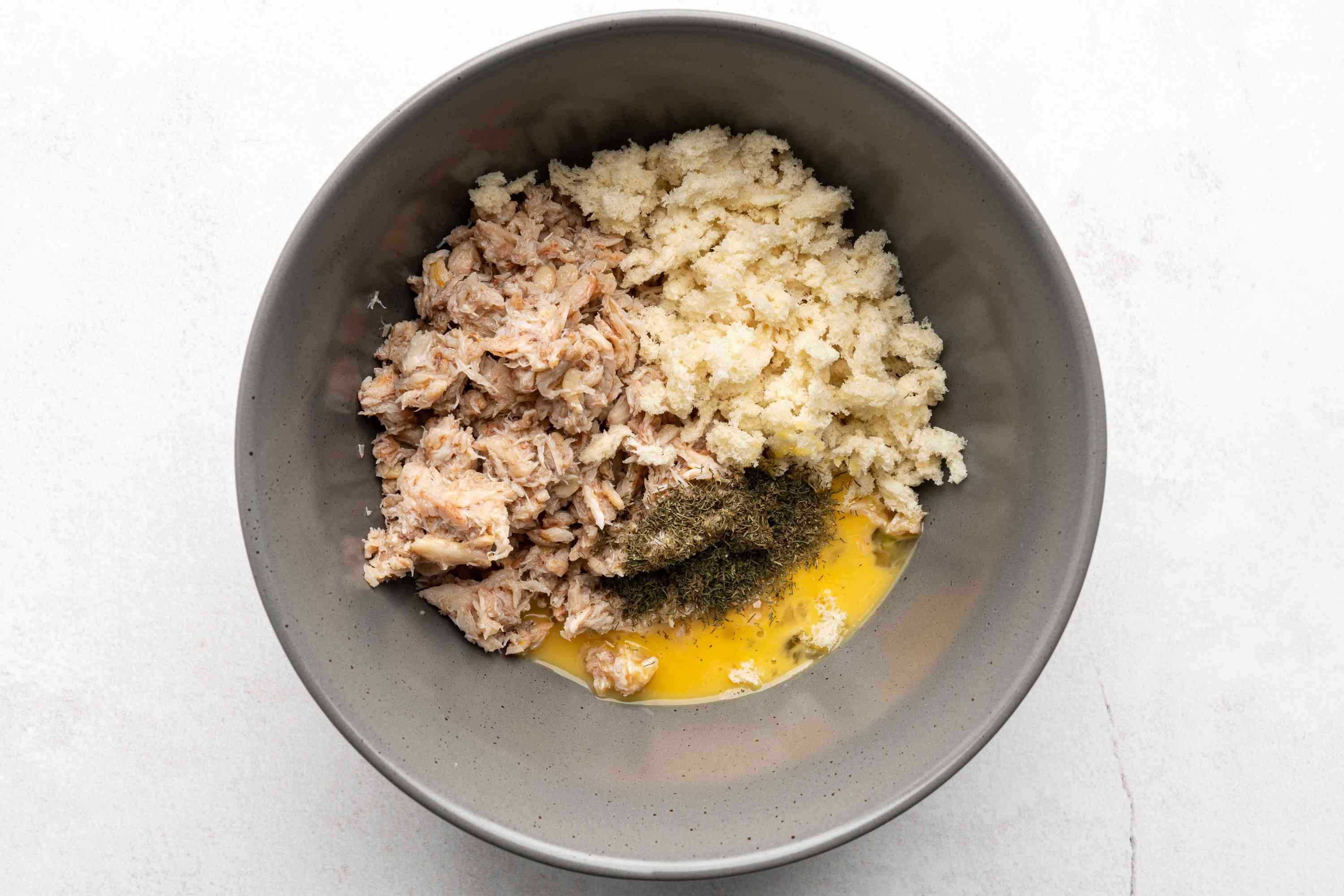 lemon juice, crab meat, breadcrumbs, egg, and dill to the bowl