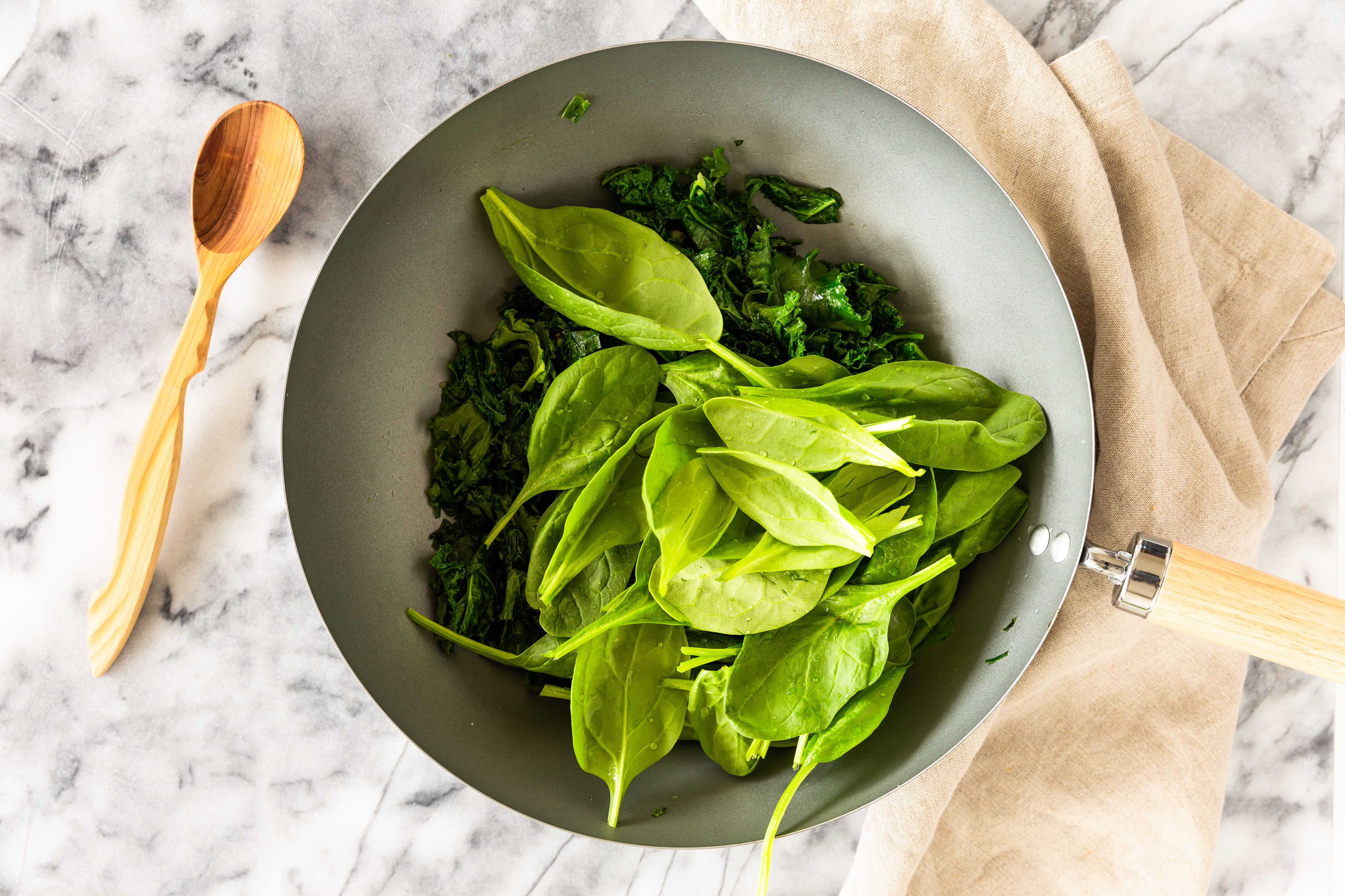 Add spinach to pan with kale and chard