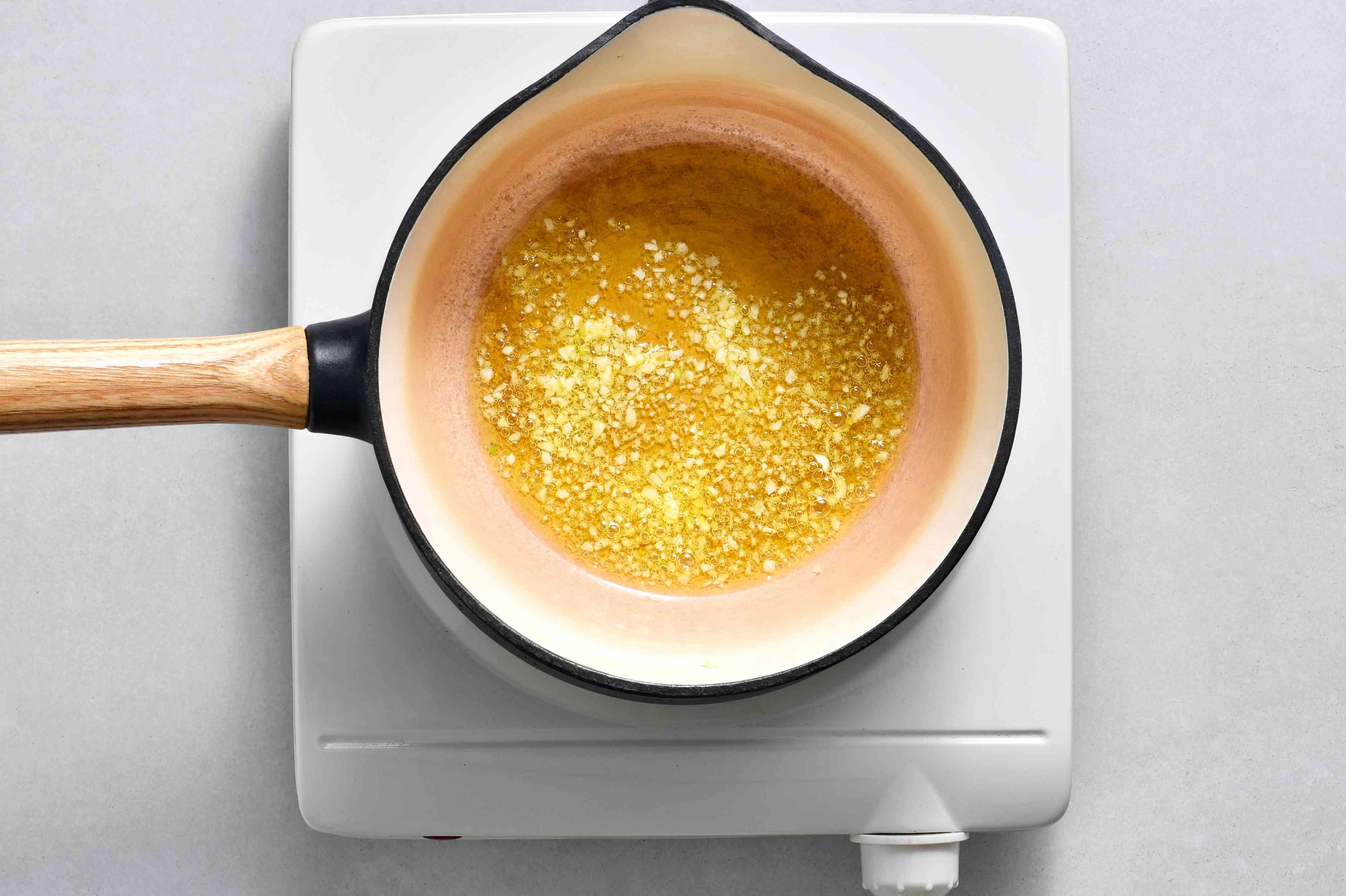 garlic and oil in a saucepan