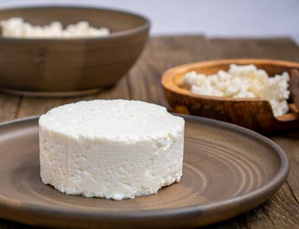 Homemade Queso Fresco Cheese recipe, cheese on a brown plate
