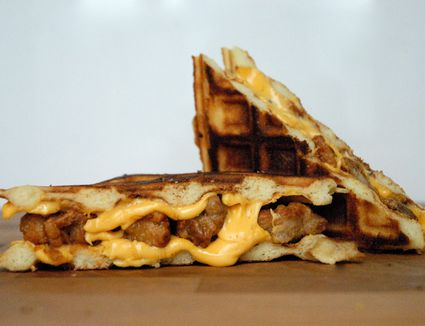 Fried Chicken and Waffle Grilled Cheese with Hot Sauce and Honey