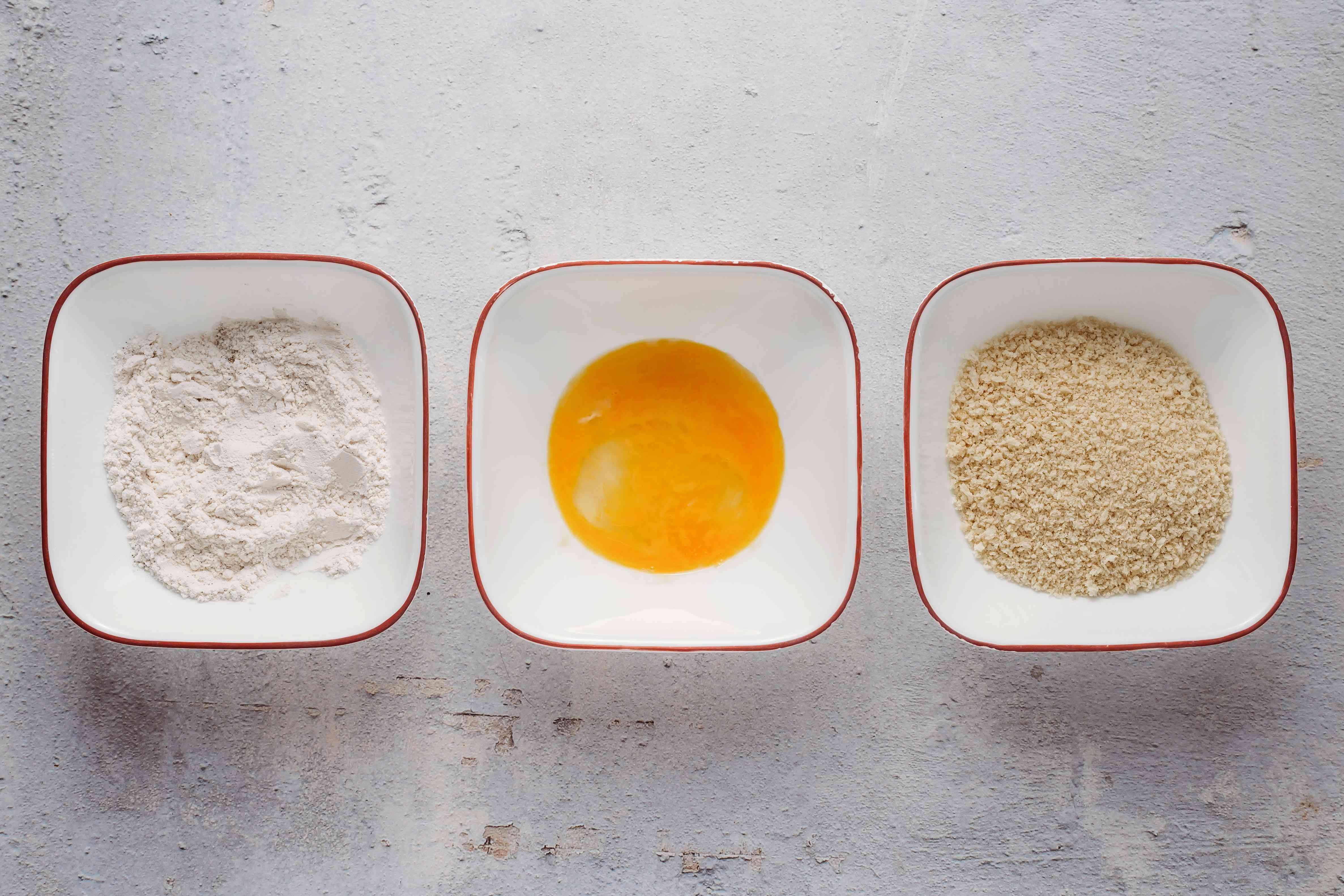 bowls with flour, beaten egg and panko