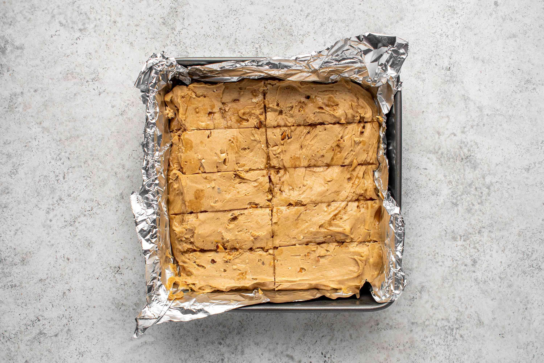 peanut butter bar pieces in a baking pan