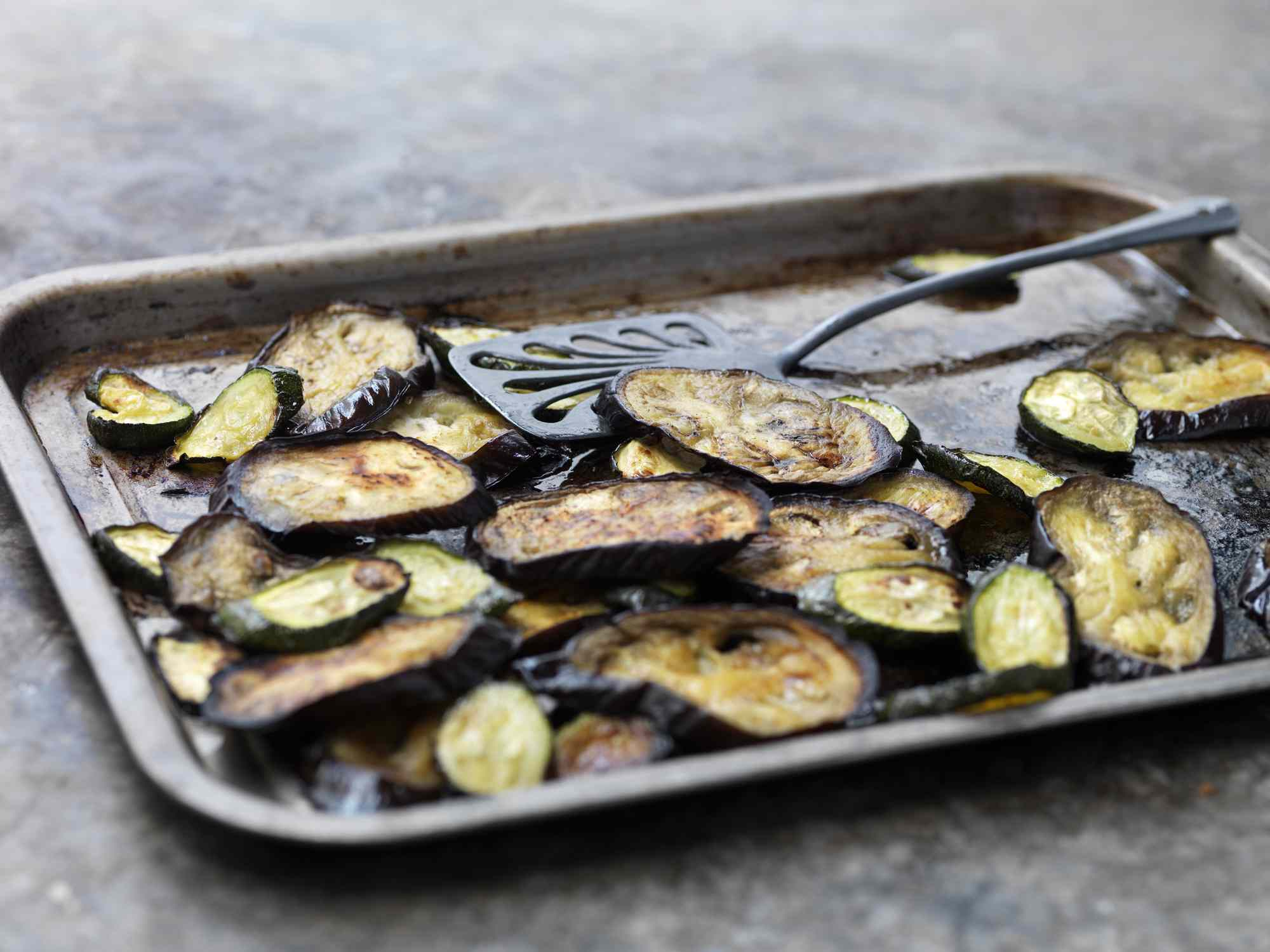 Sliced cooked eggplant on a pan