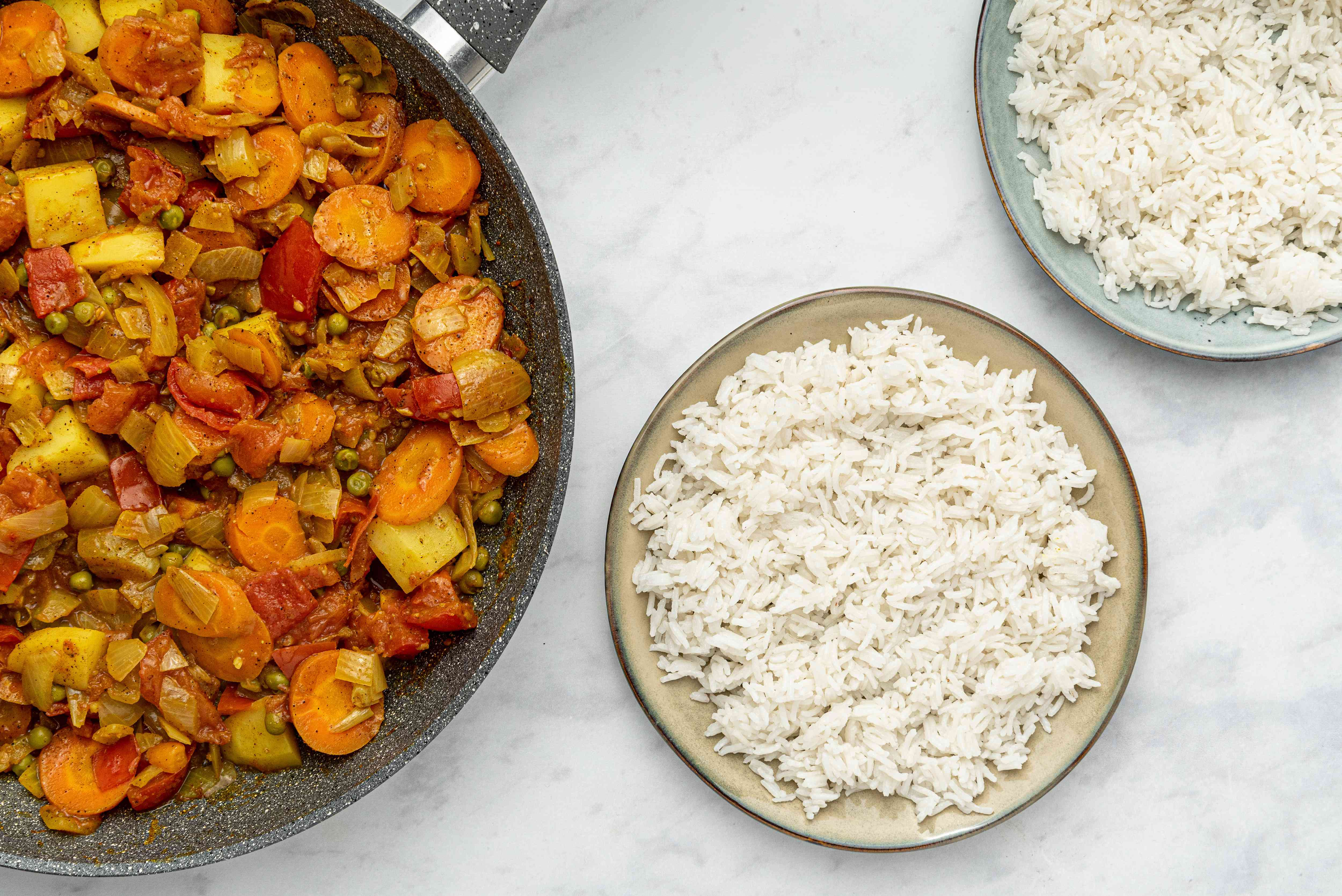 Easy Curried Indian Vegetables in a pan, served with white rice