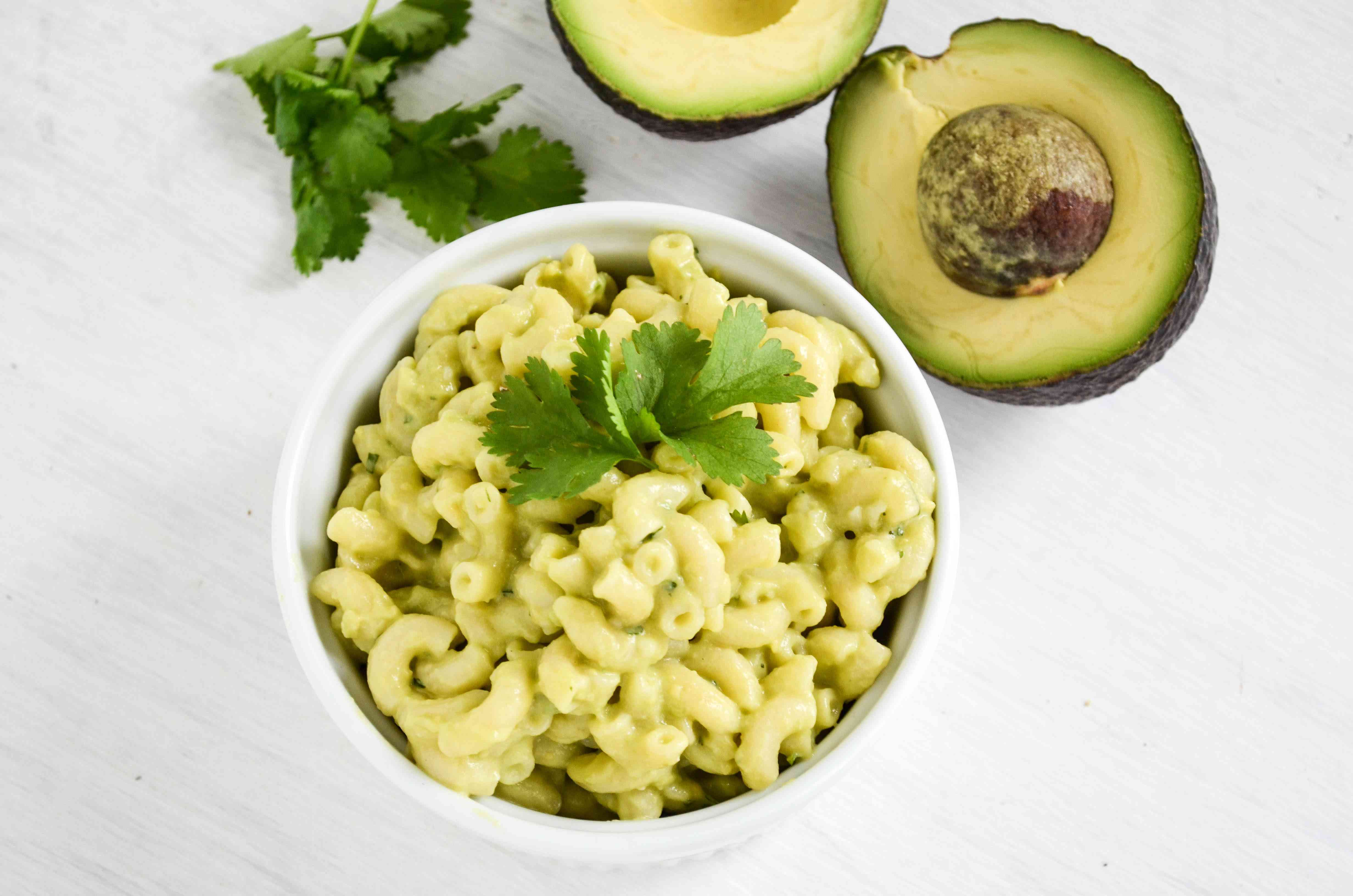 Creamy avocado mac and cheese in a serving bowl