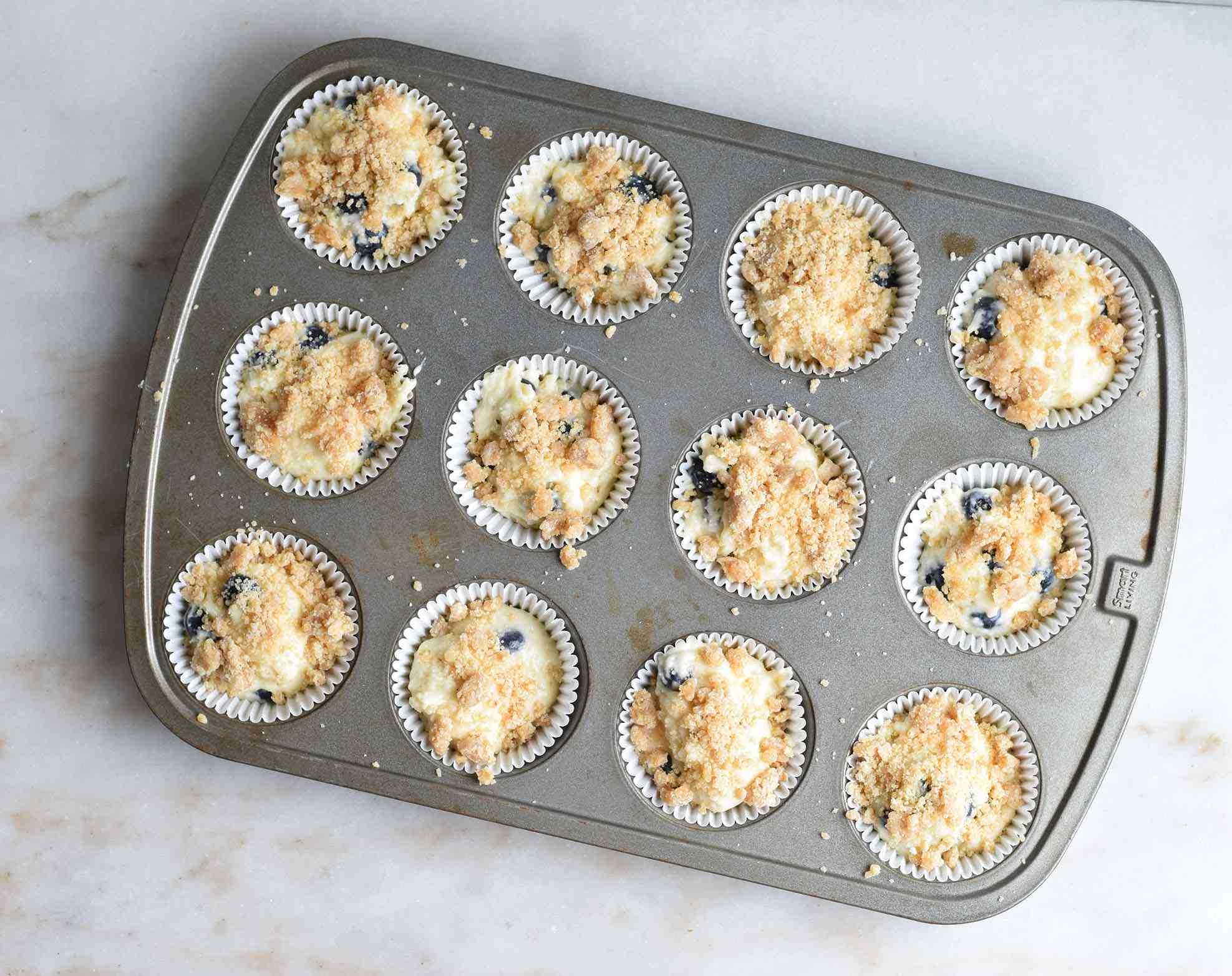 muffin batter topped with streusel topping