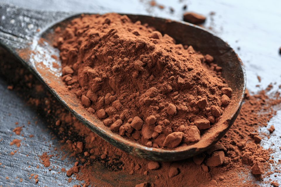Close-Up Of Spoon With Cocoa Powder On Table