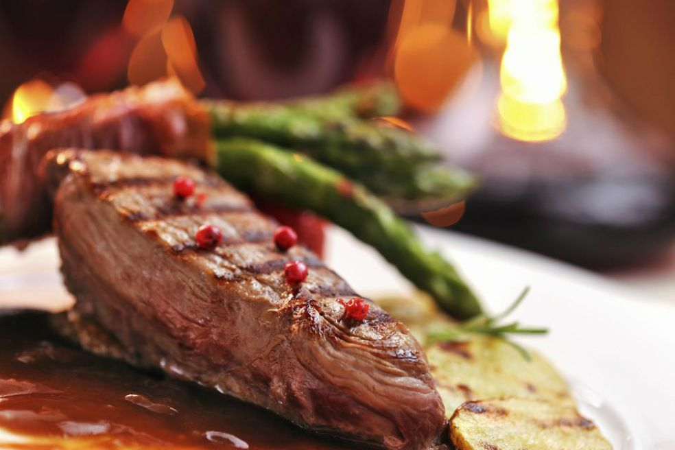 Top round Tuscan steak served with asparagus and sliced potato
