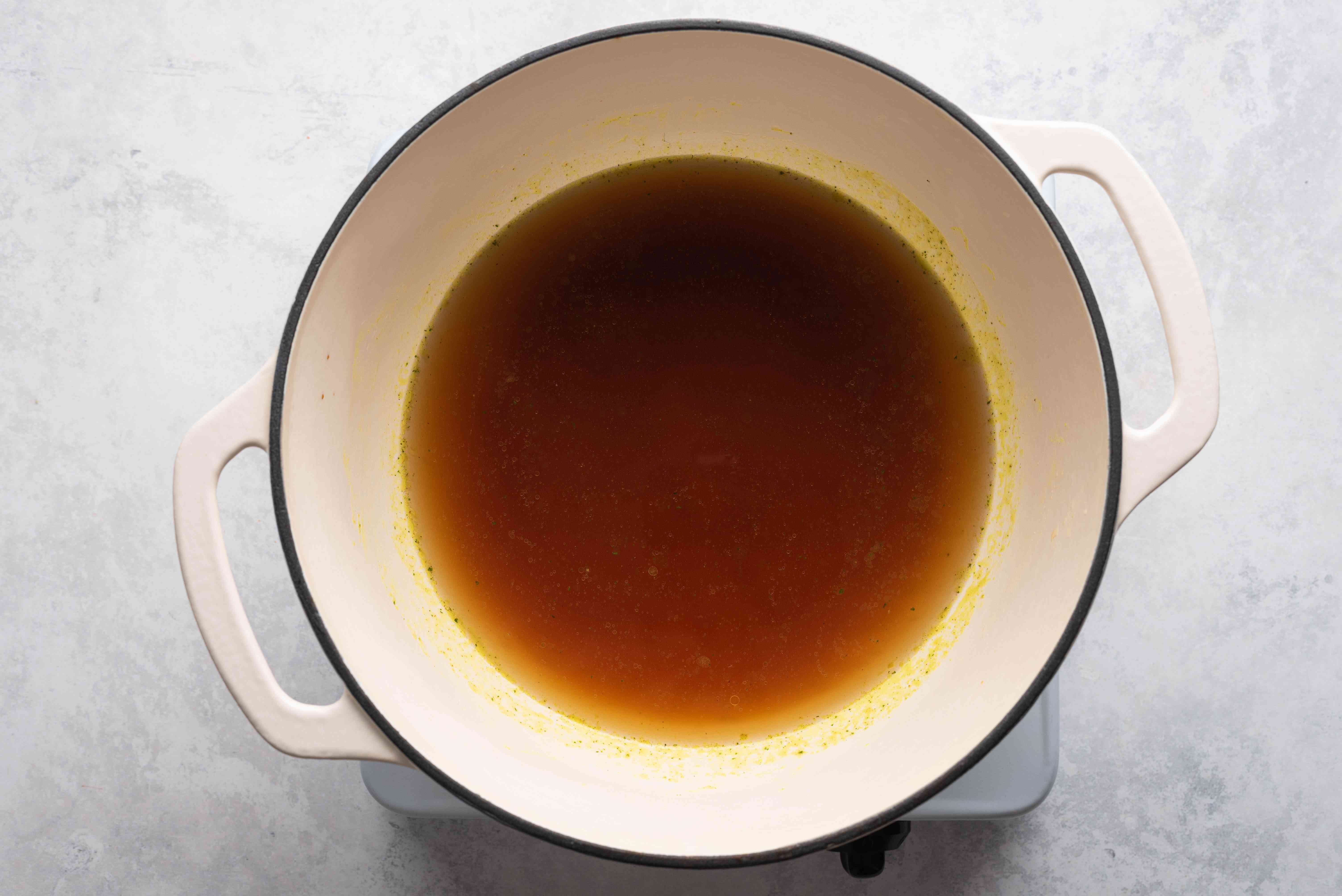 heat the chicken broth and 2 tablespoons soy sauce