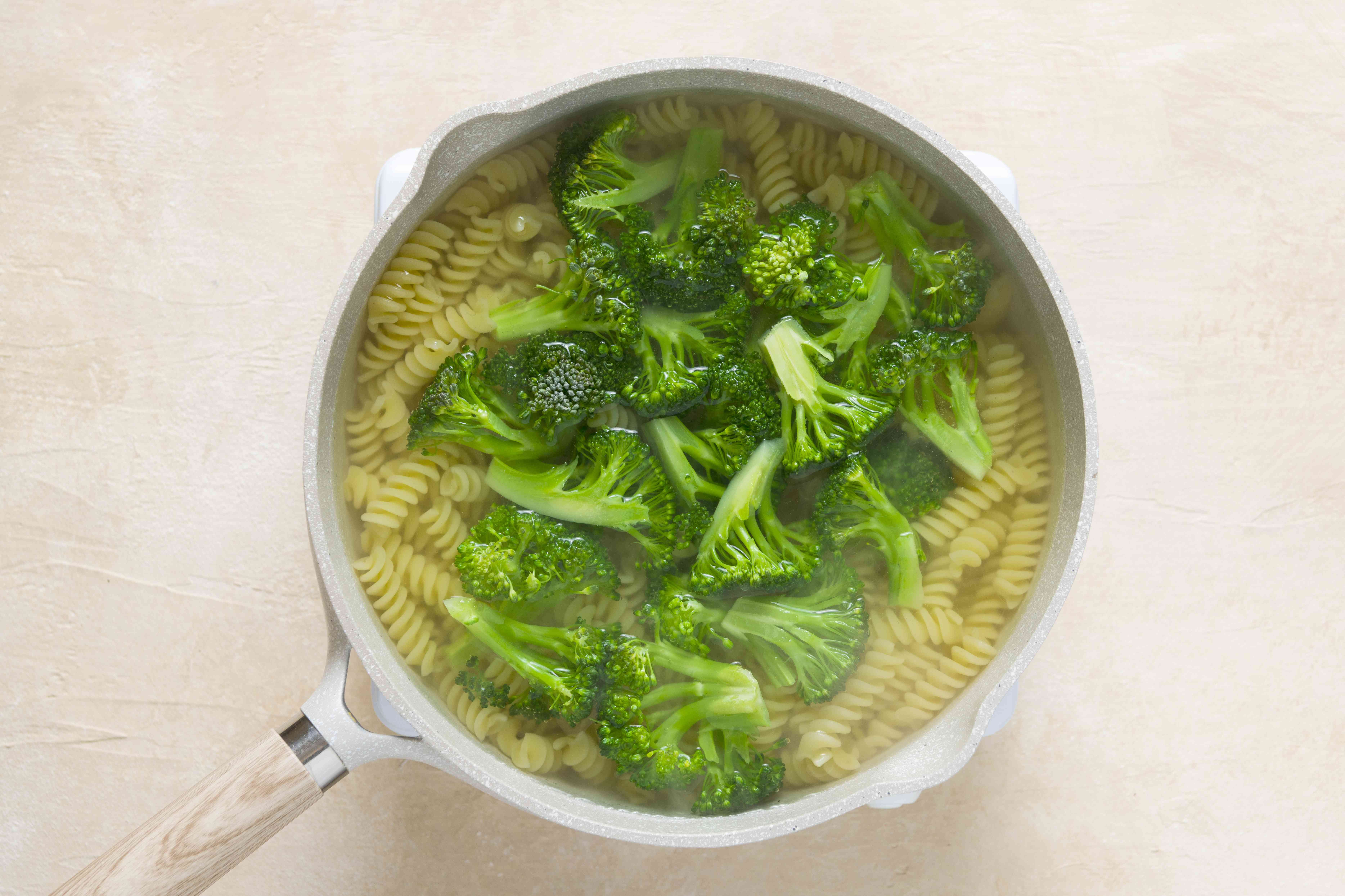 broccoli and pasta in a pot with water