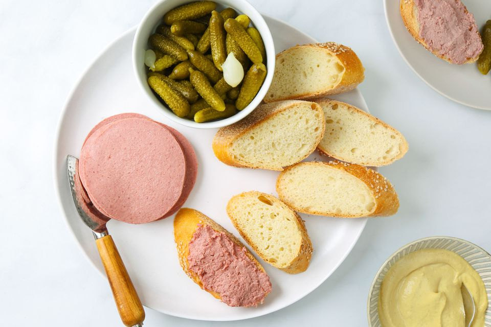 Liverwurst served with bread, mustard, and cornichons