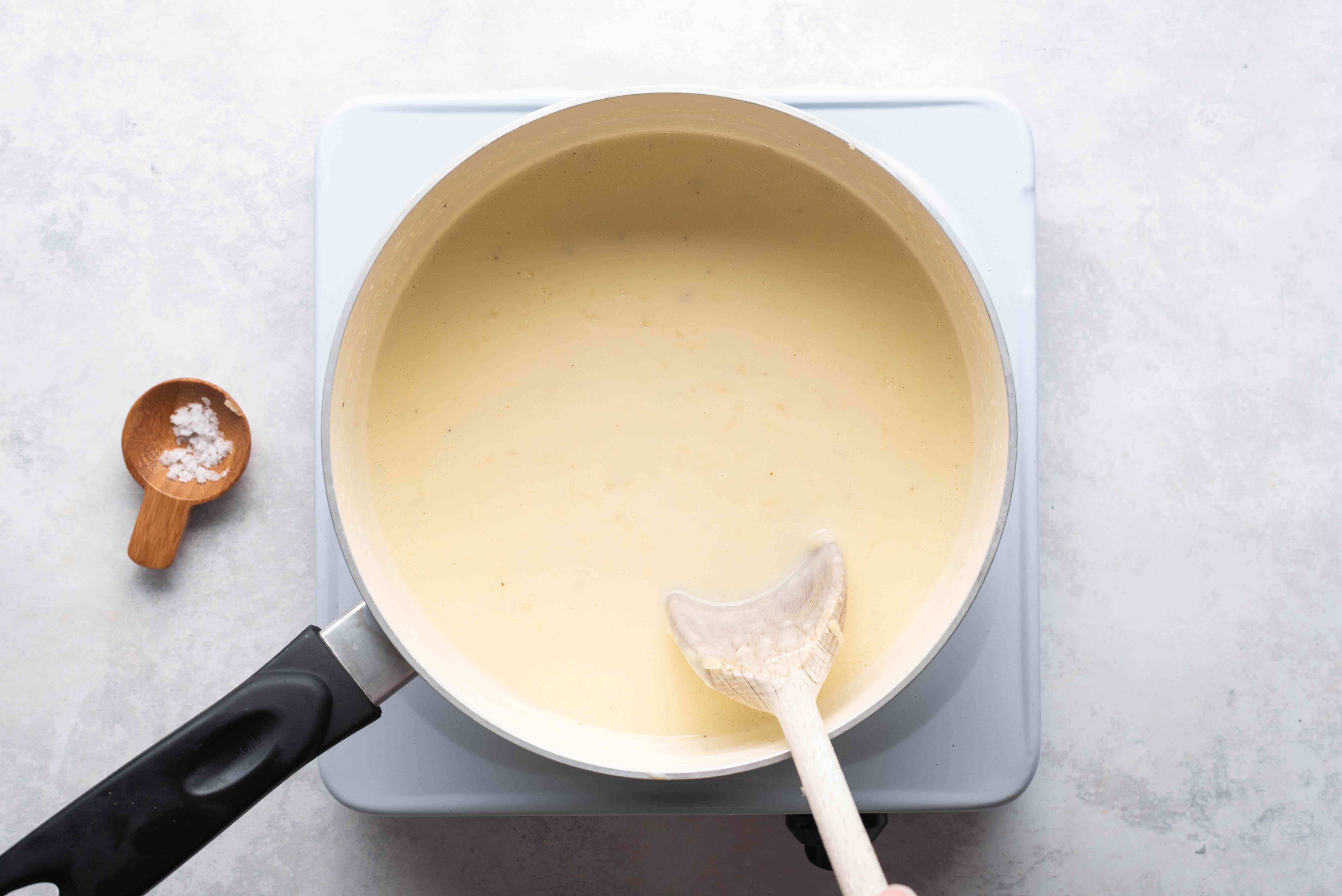 cheese sauce in the saucepan