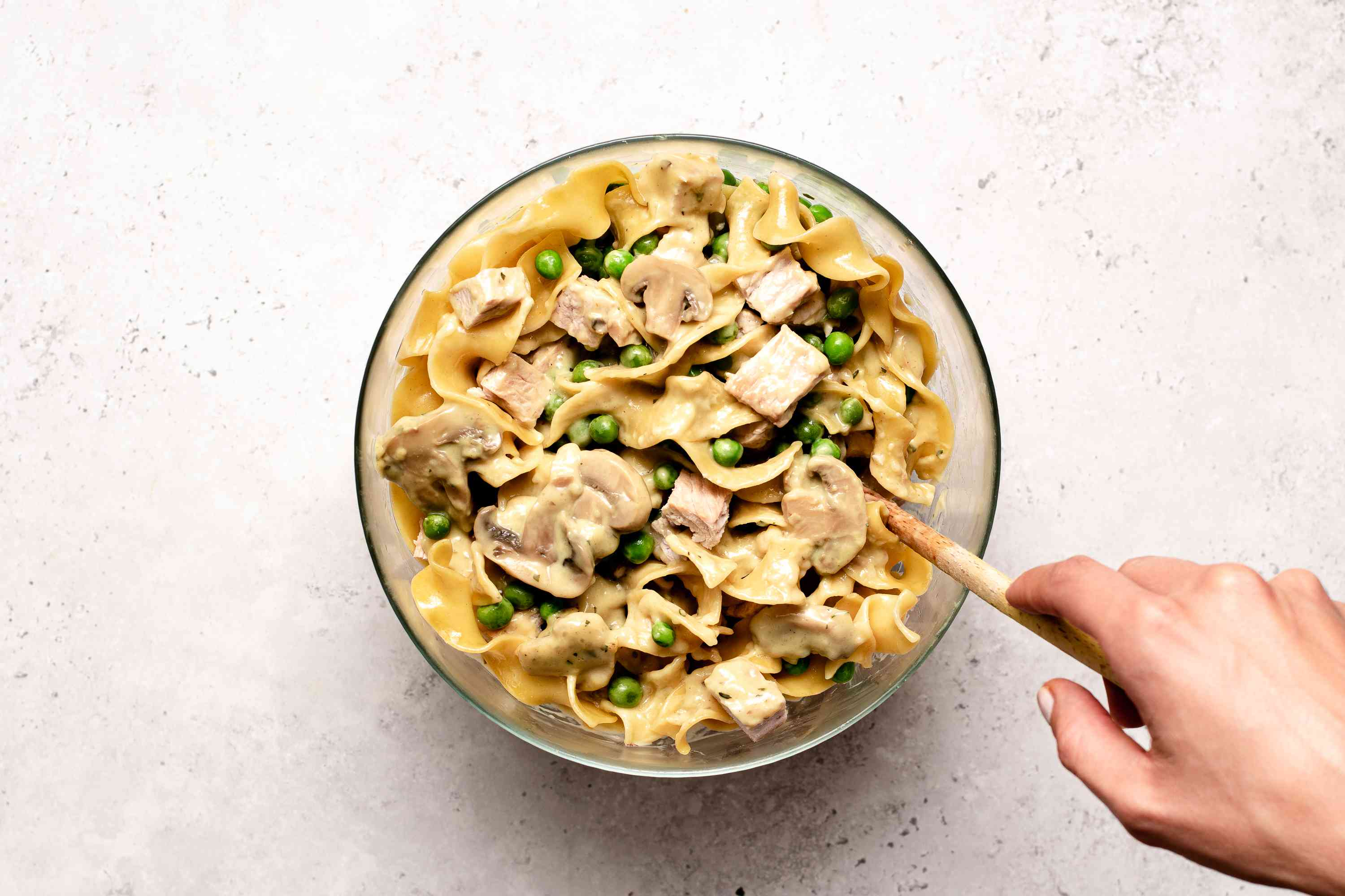 Soup mixture with turkey and noodle mixture in bowl