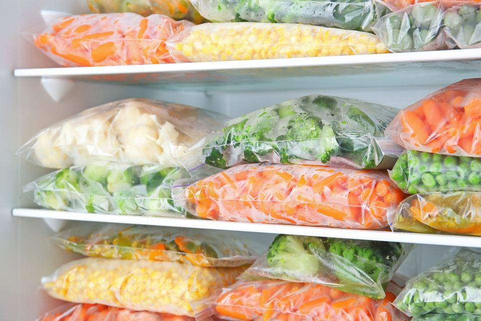 Bags of vegetables in a freezer