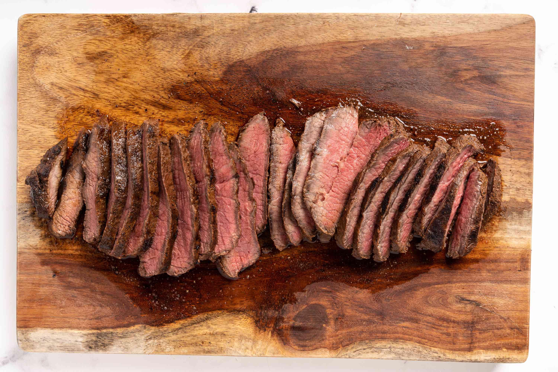 steak slices on a wood board