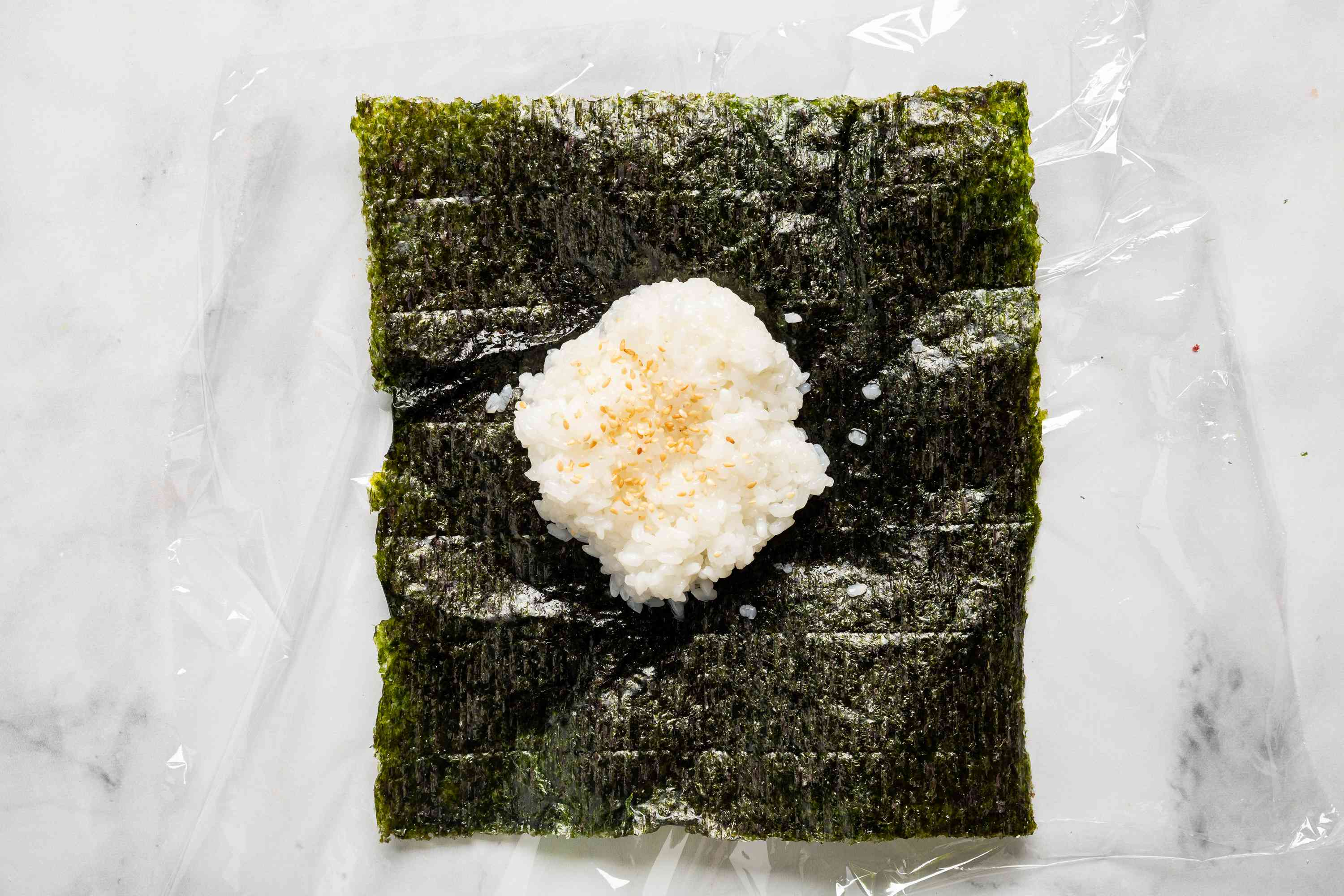 rice on top of a seaweed sheet