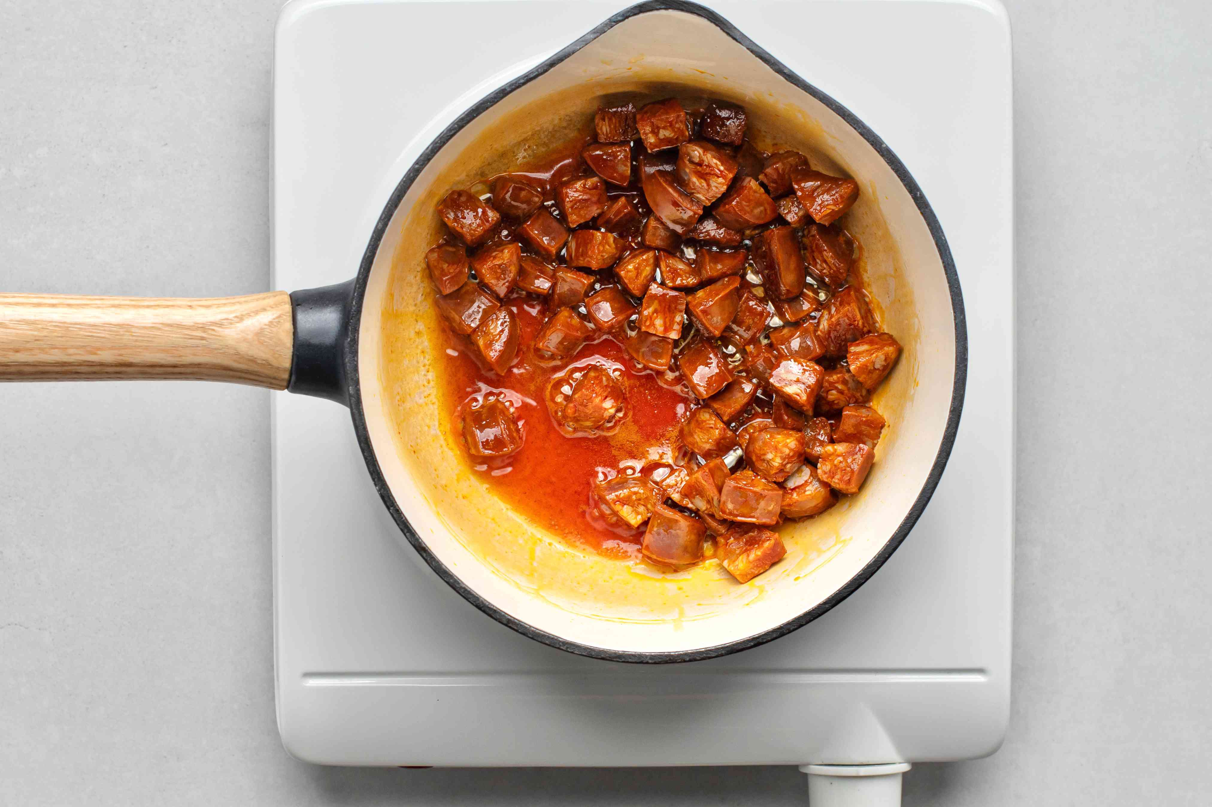 Cook the chorizo until some of the fat has rendered