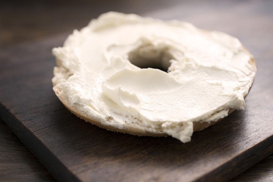 Half a bagel with cream cheese