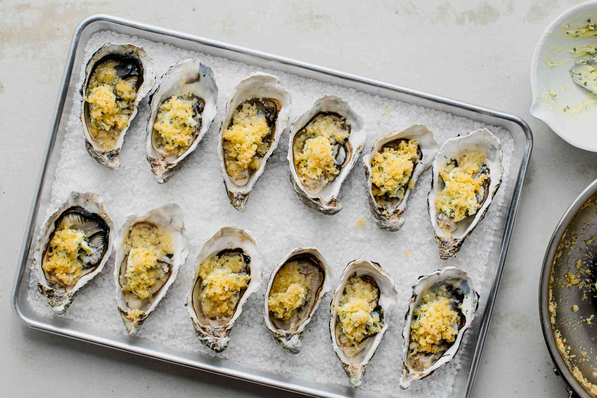 Prepared oysters in a pan ready to be baked