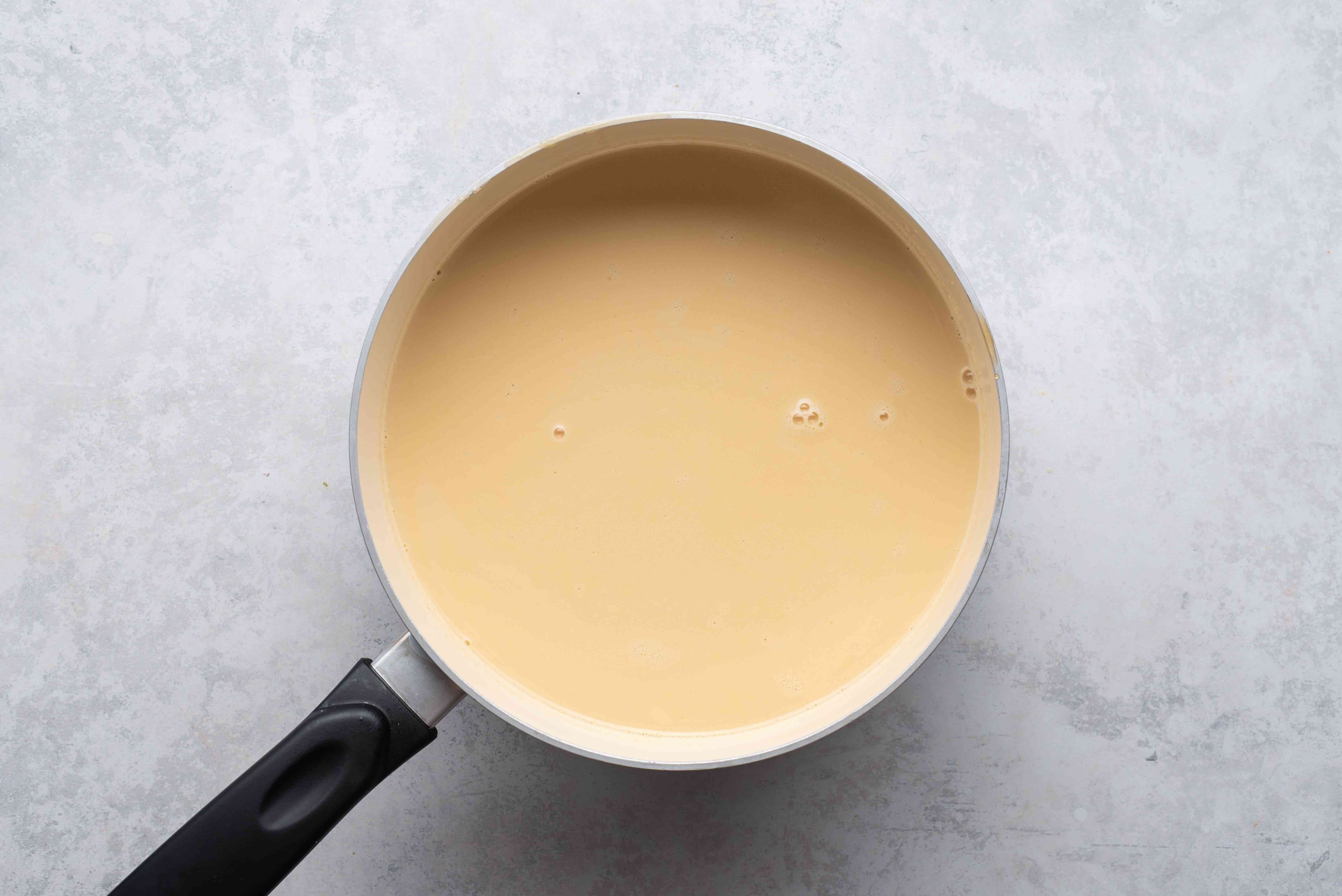maple syrup with cream in a saucepan