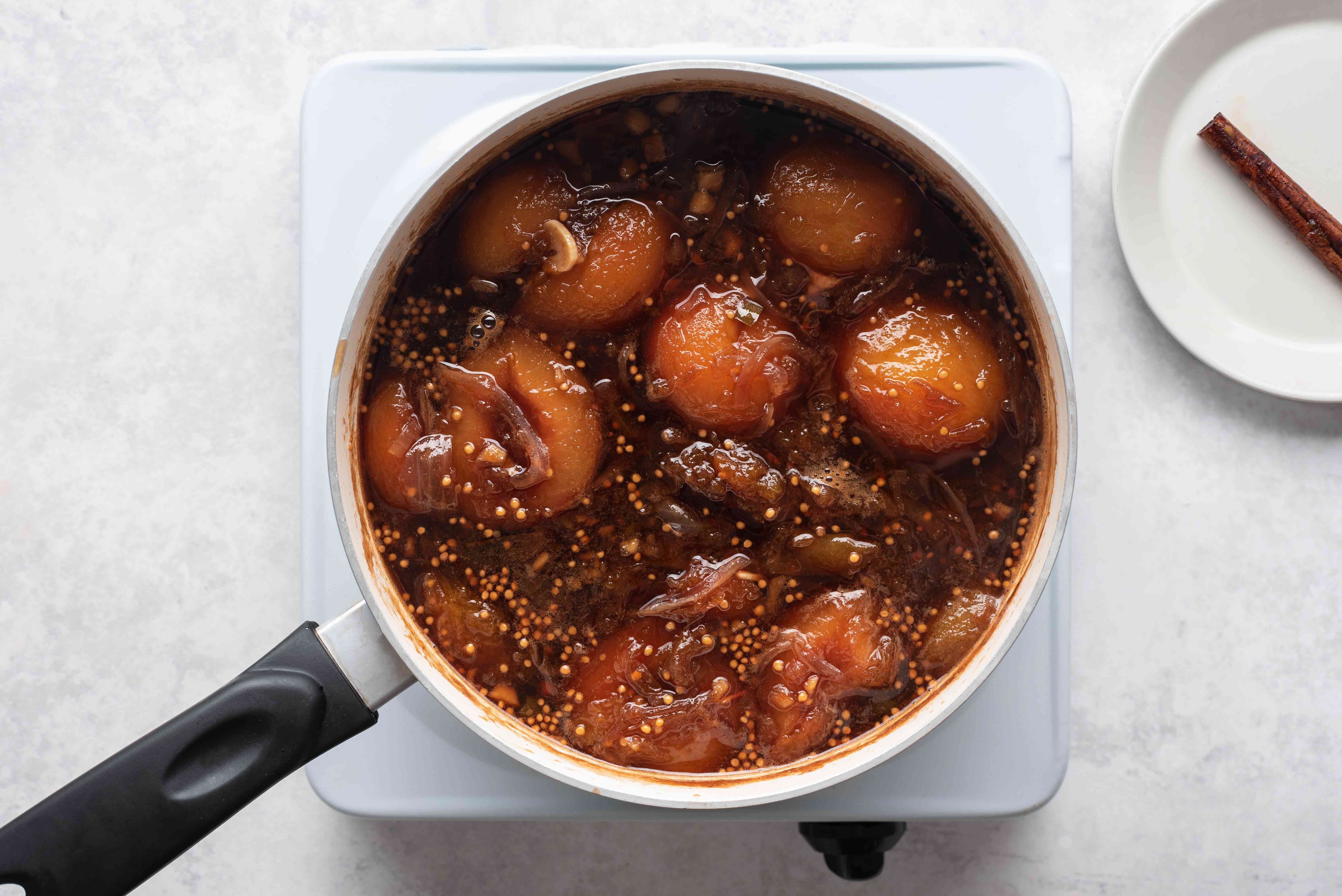 sauce cooking in a saucepan