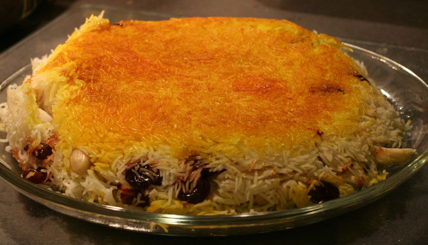 A tahdig rice dish with added cherries