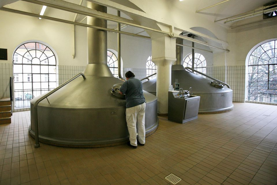Brew kettles boil wort before fermented into beer at the Weihenstephan brewery on November 16, 2009 in Freising, Germany.