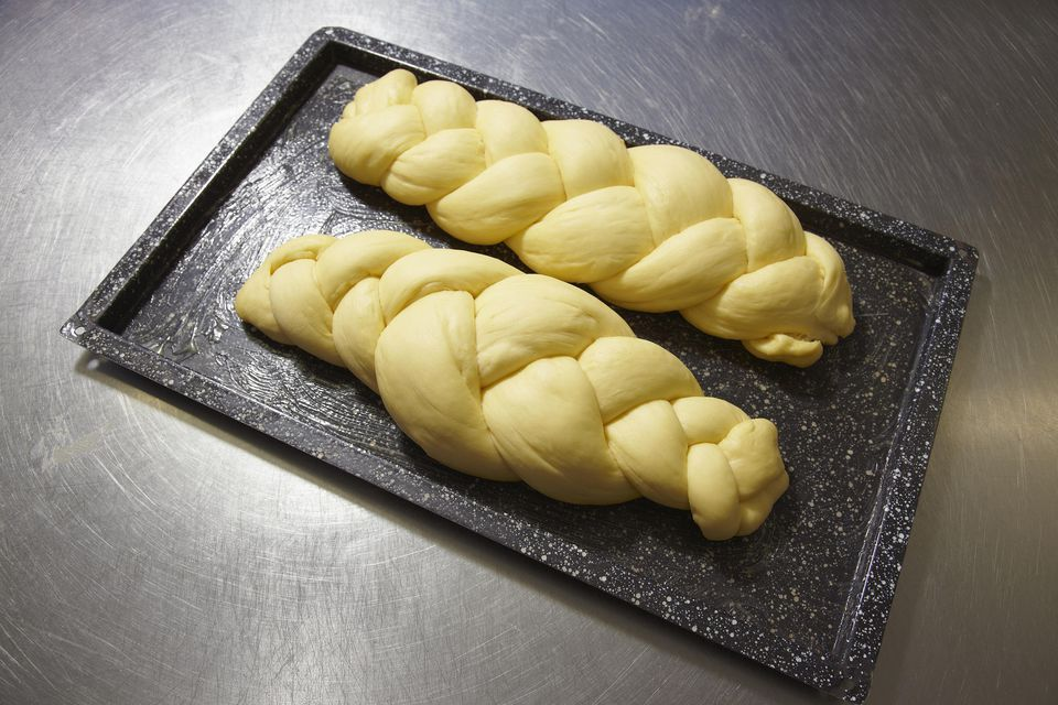 Two loaves of braided bread waiting to be baked