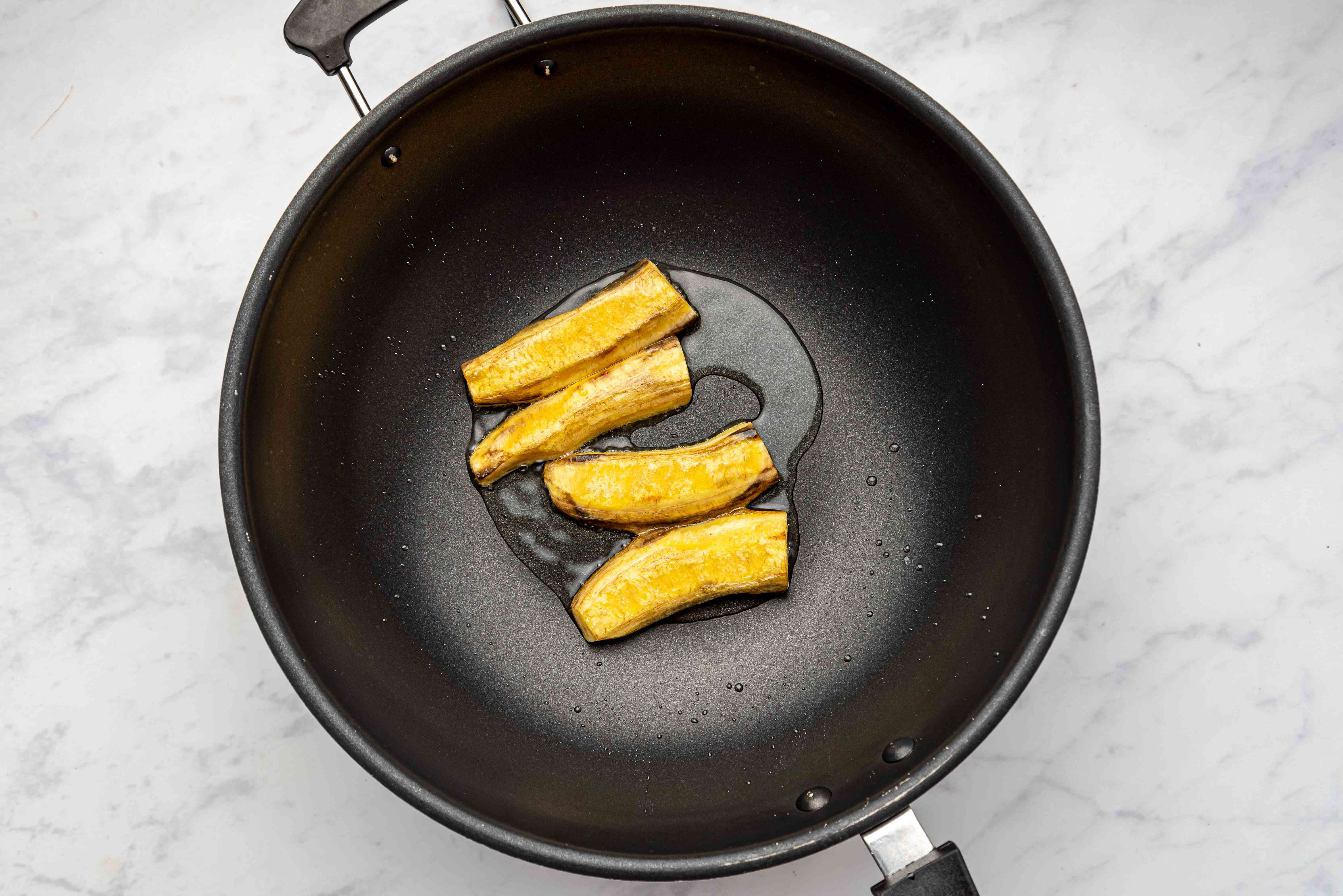 plantains cooking in a pan