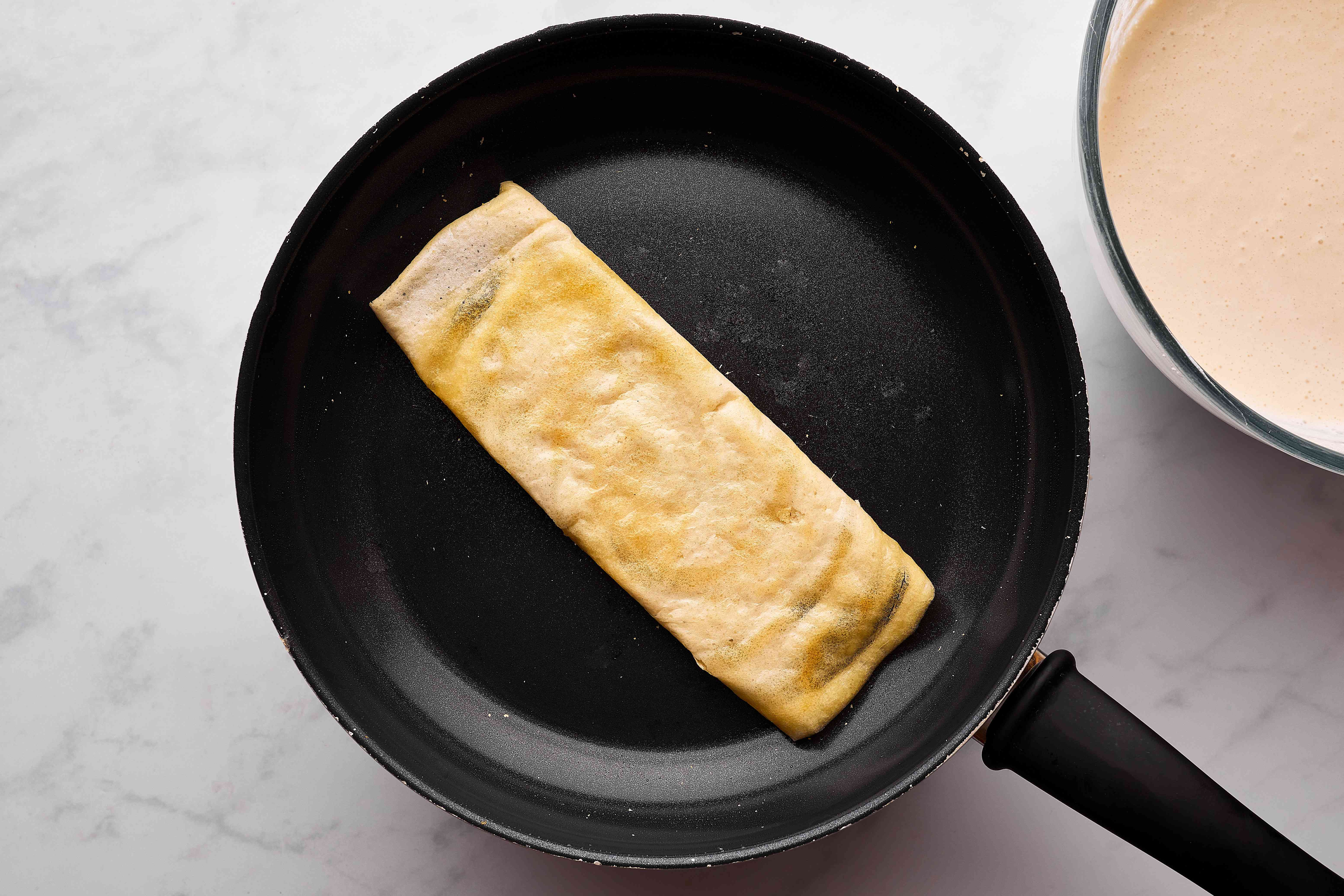 Folded dosa in a pan