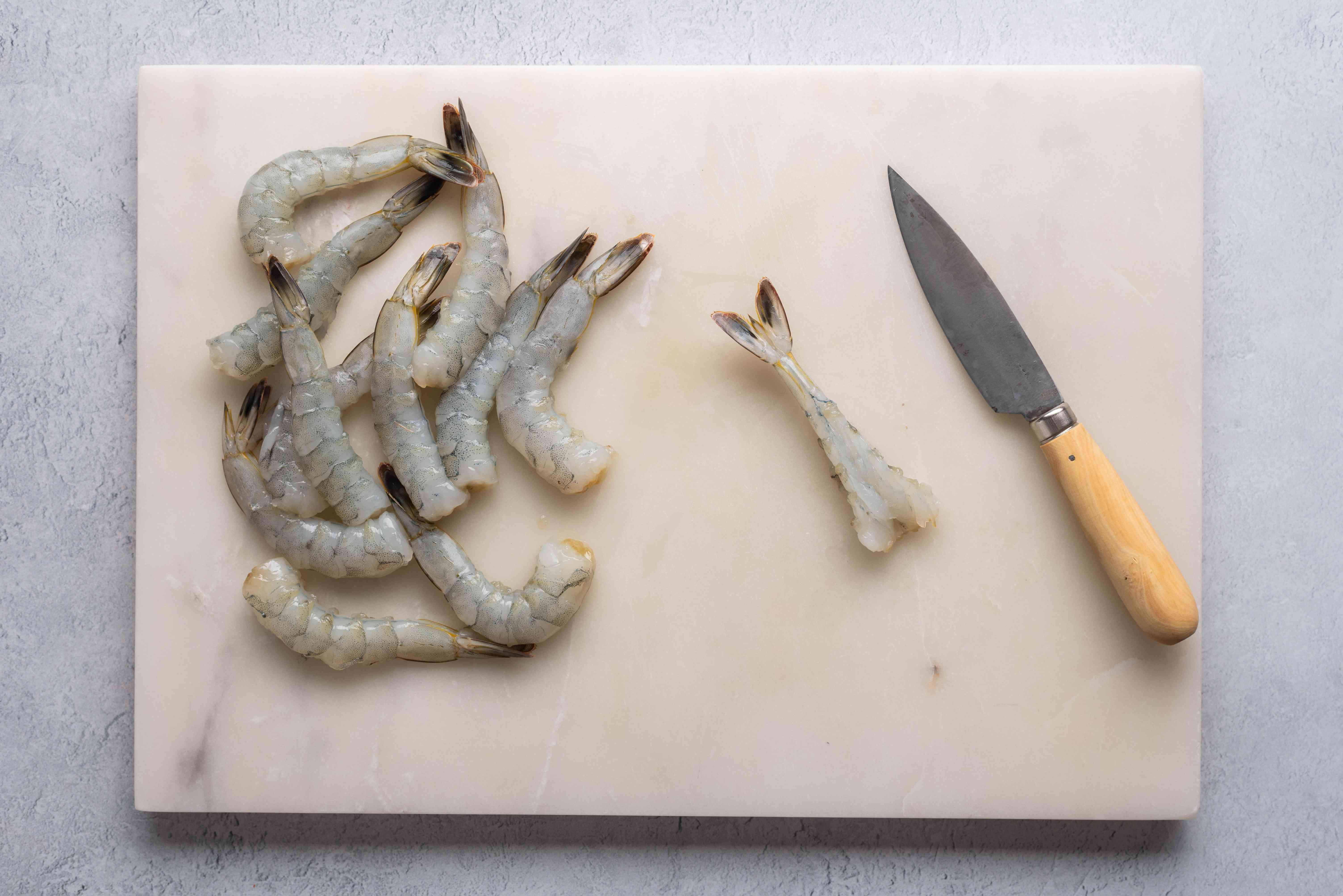 Place the shrimp on a cutting board and make another cut along the inside curve of the shrimp