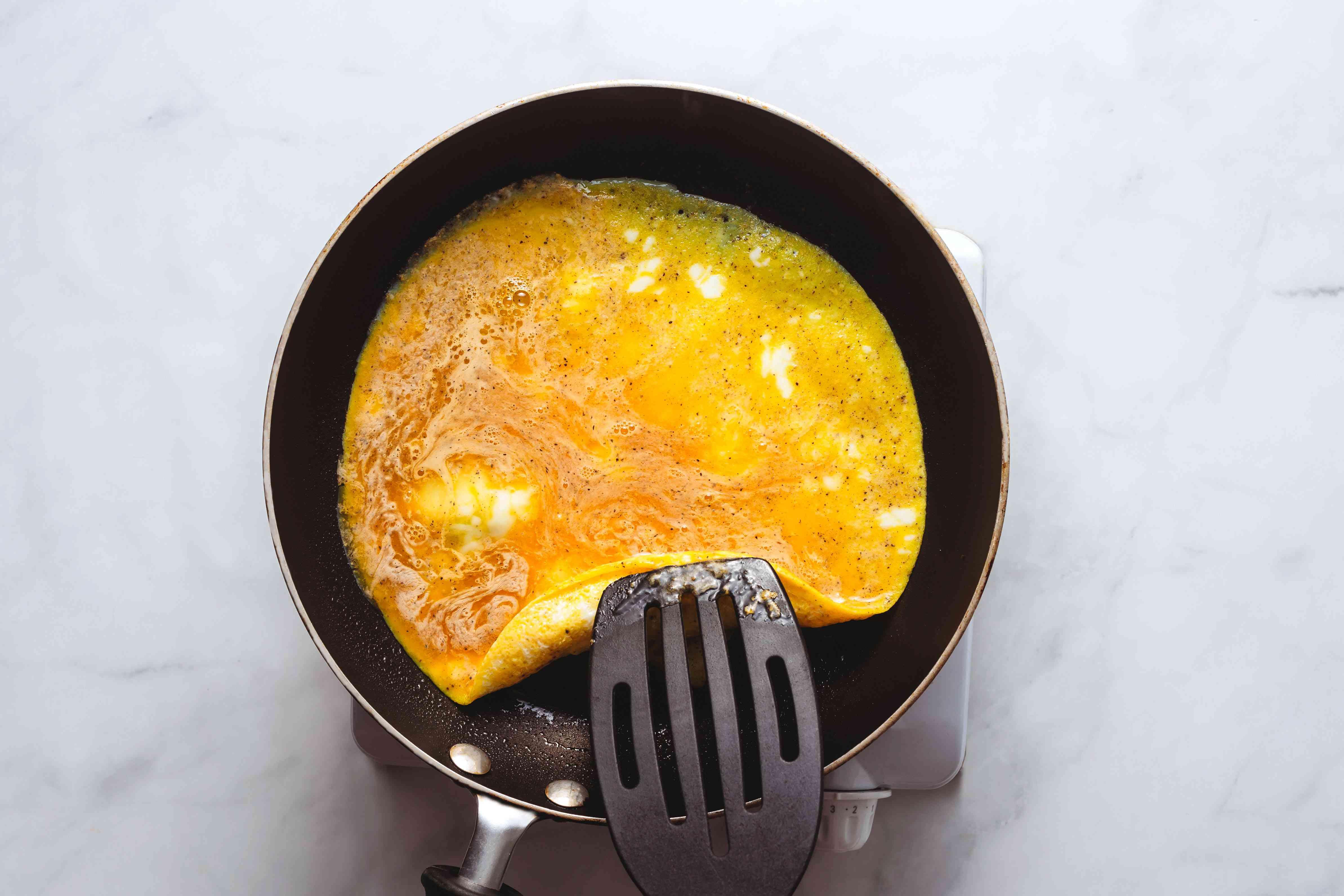 lift the omelet edges in the skillet