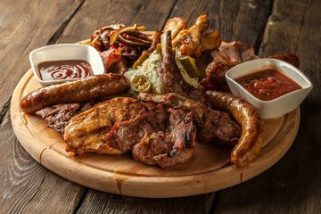 barbecue meats on a serving board