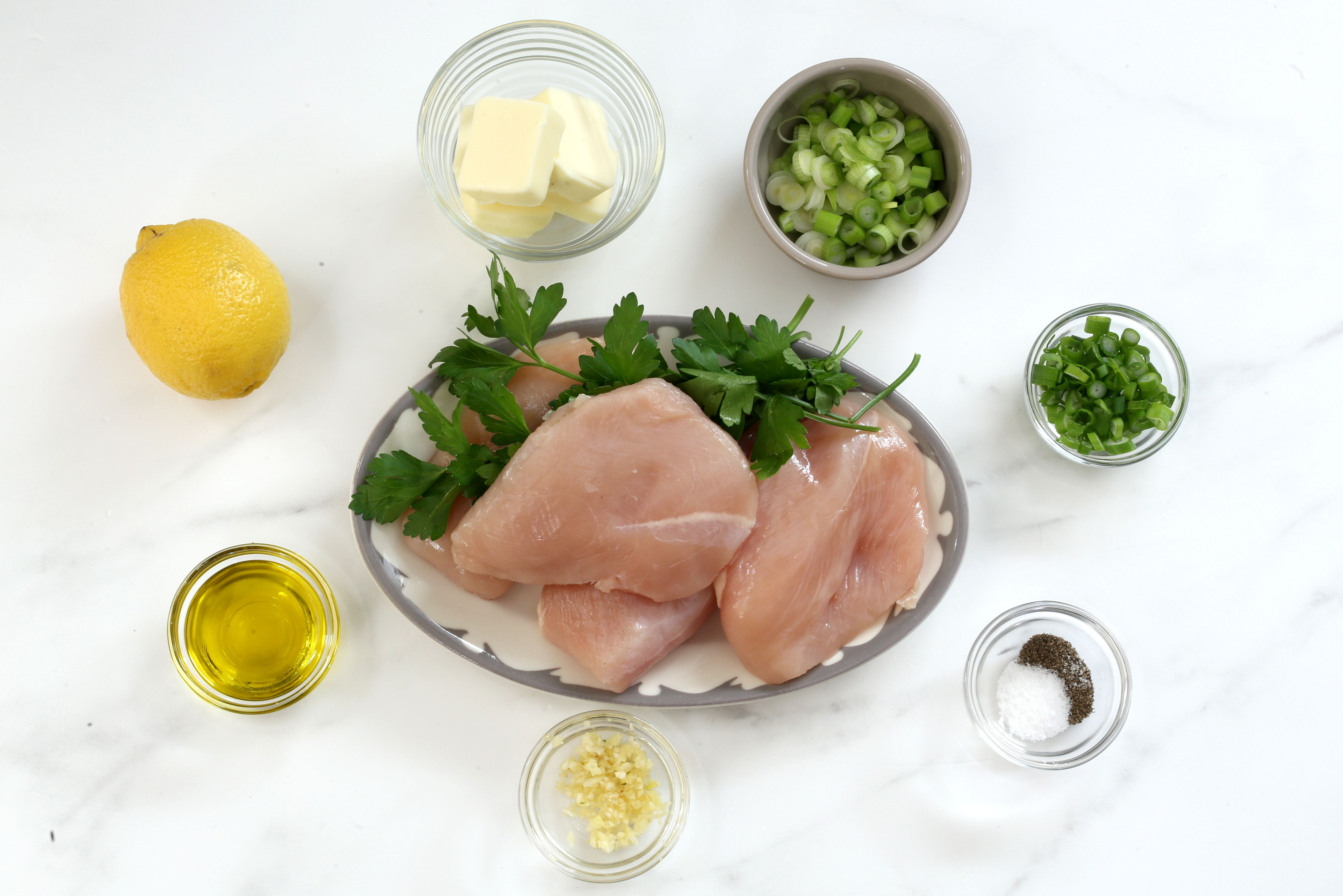 Ingredients for broiled chicken breasts and lemon butter sauce.