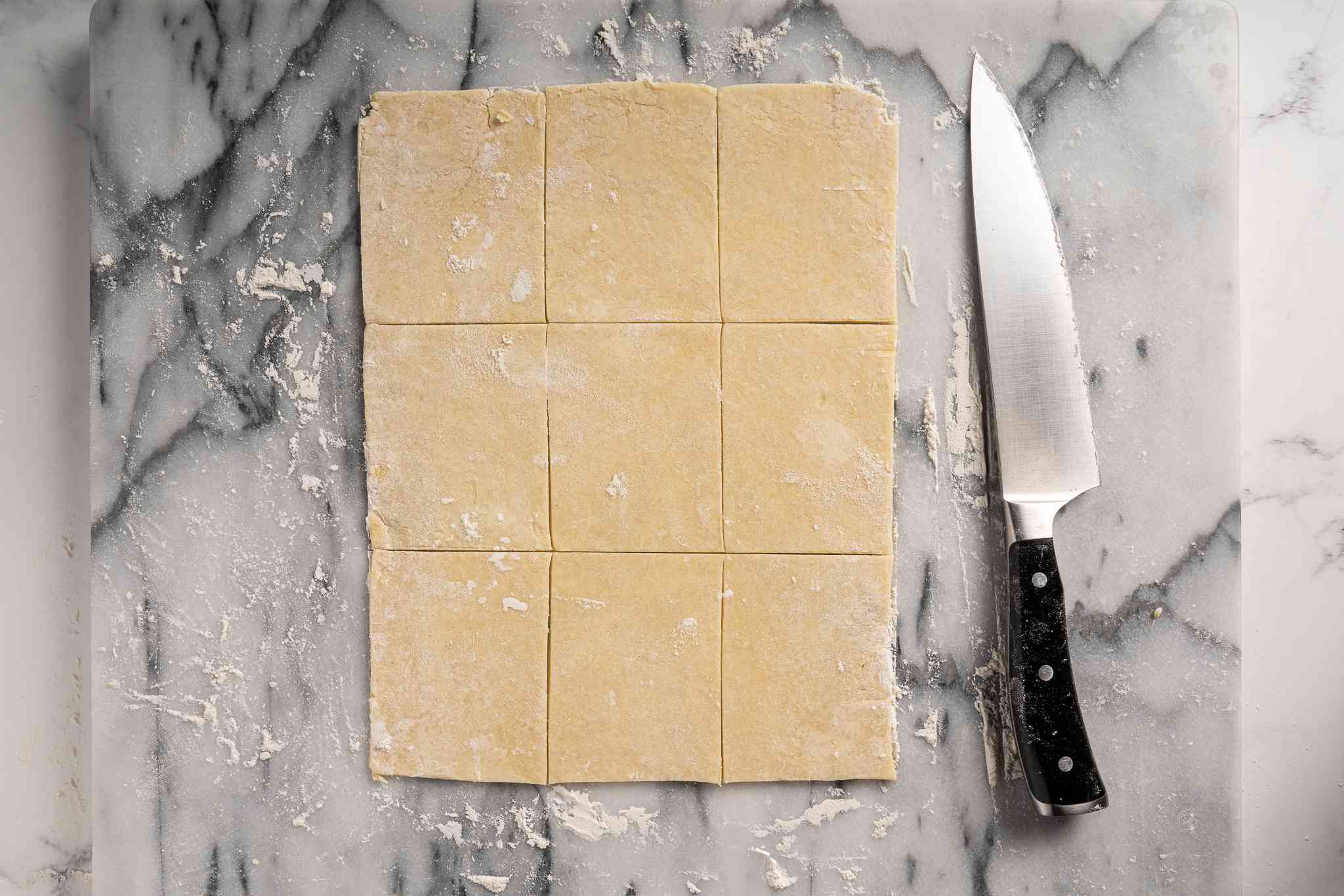Dough cut into 9 rectangles with a knife
