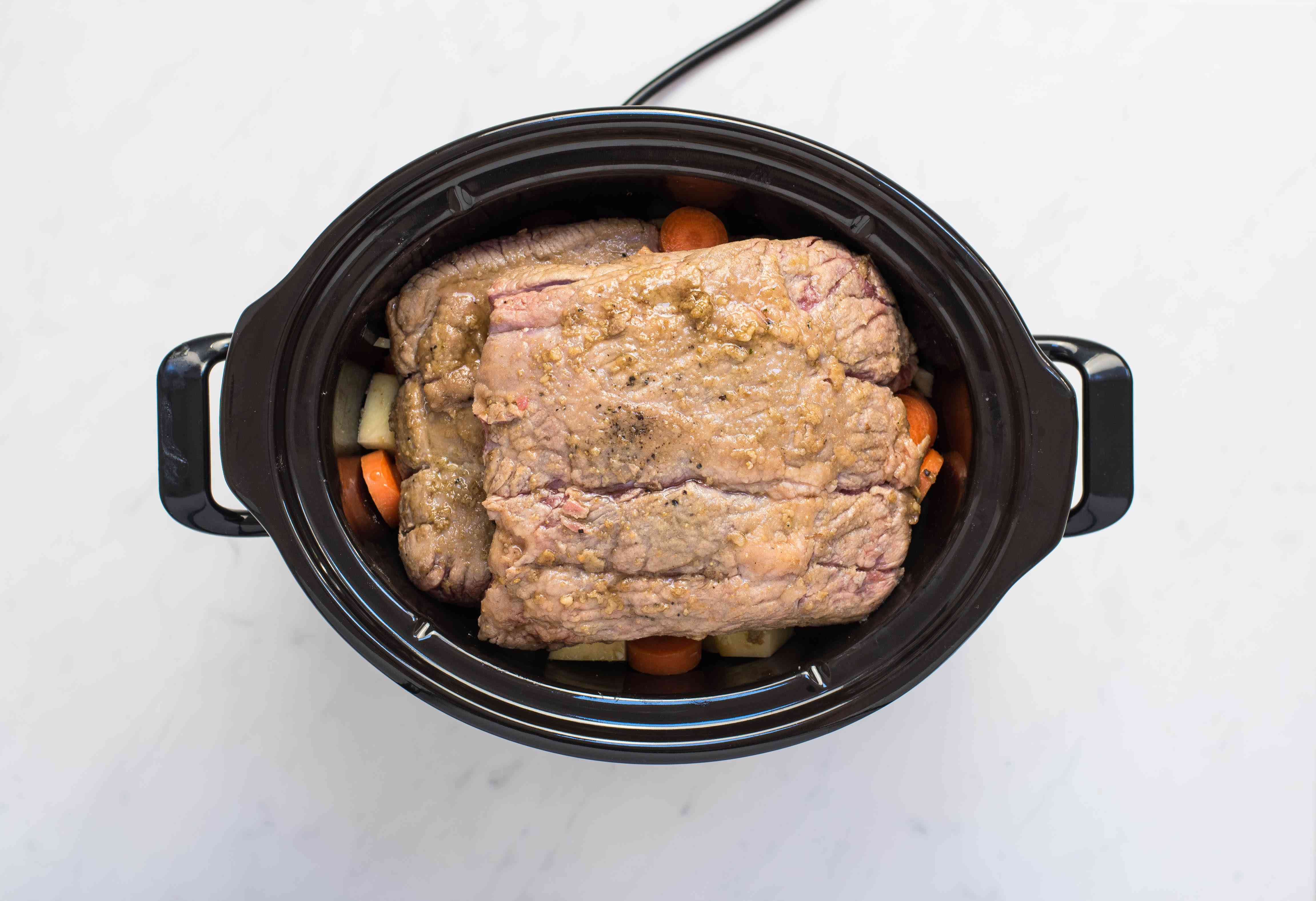 Pour juices on top of meat and other ingredients in slow cooker