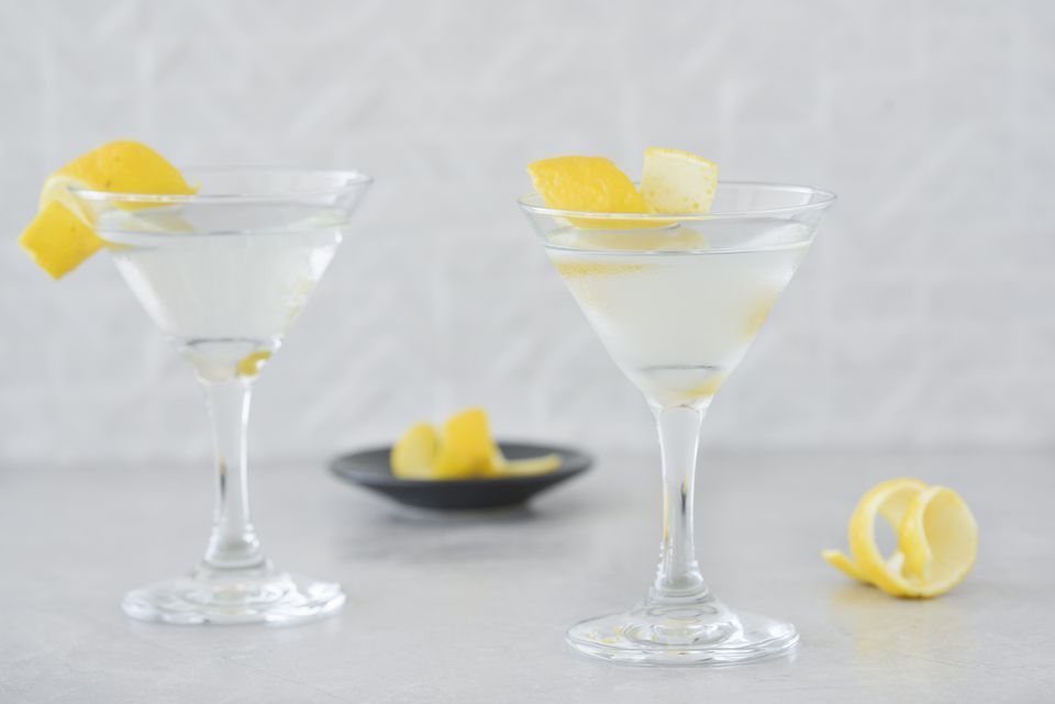 Classic gin martini garnished with lemon twists