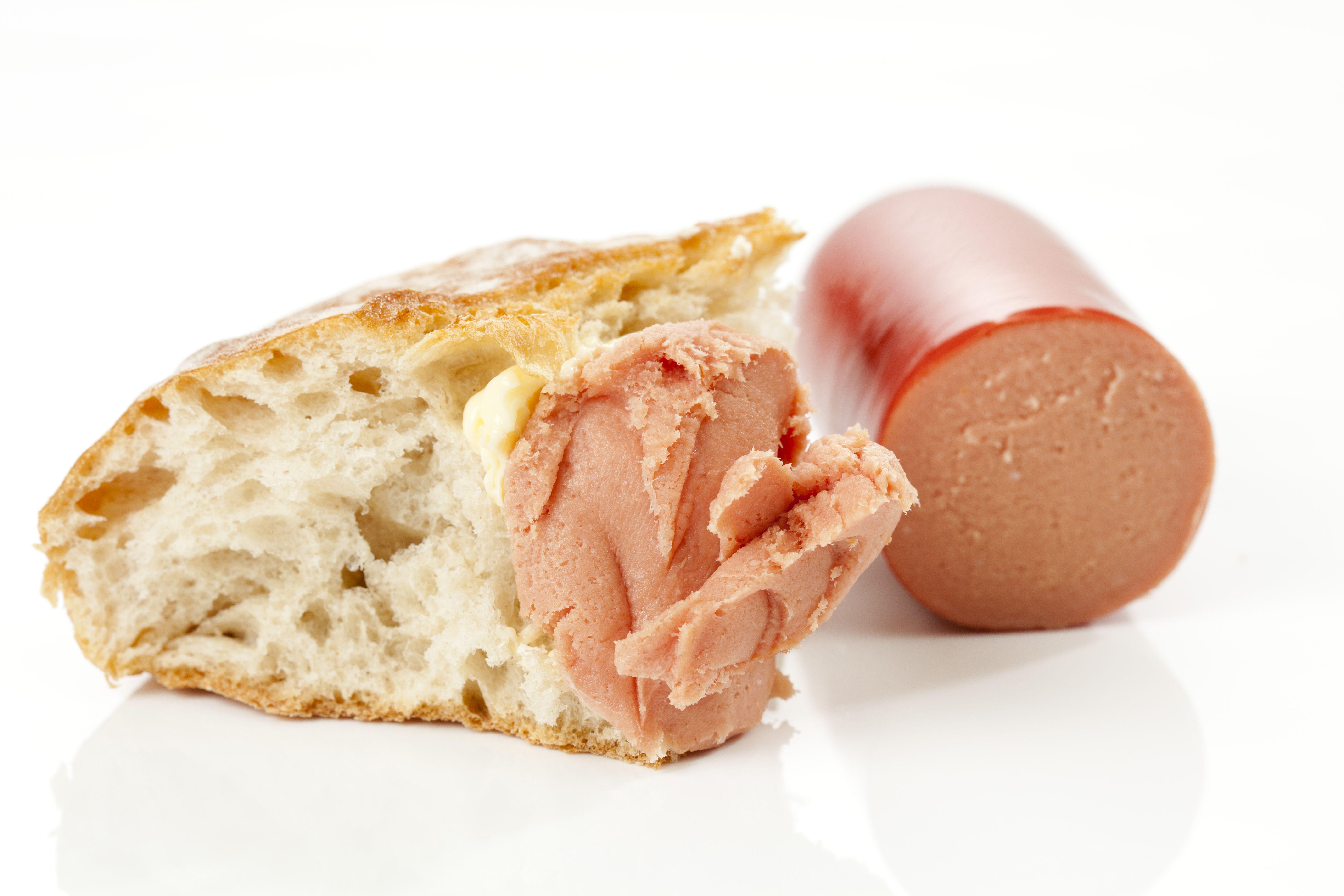 Teewurst sausage on white bread, close up