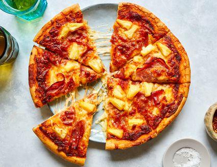 Hawaiian pizza on serving plate