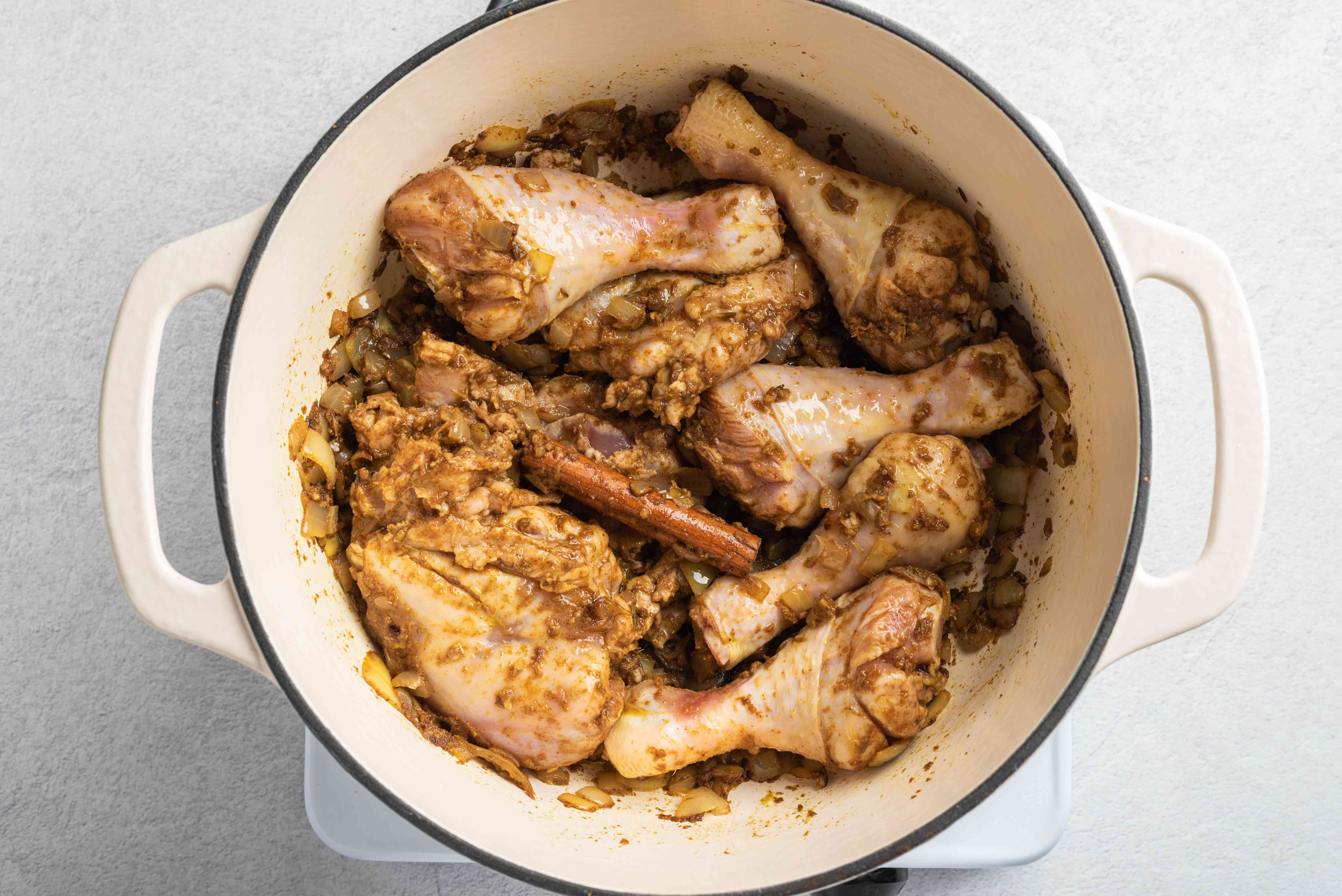 Chicken with spices in the pot