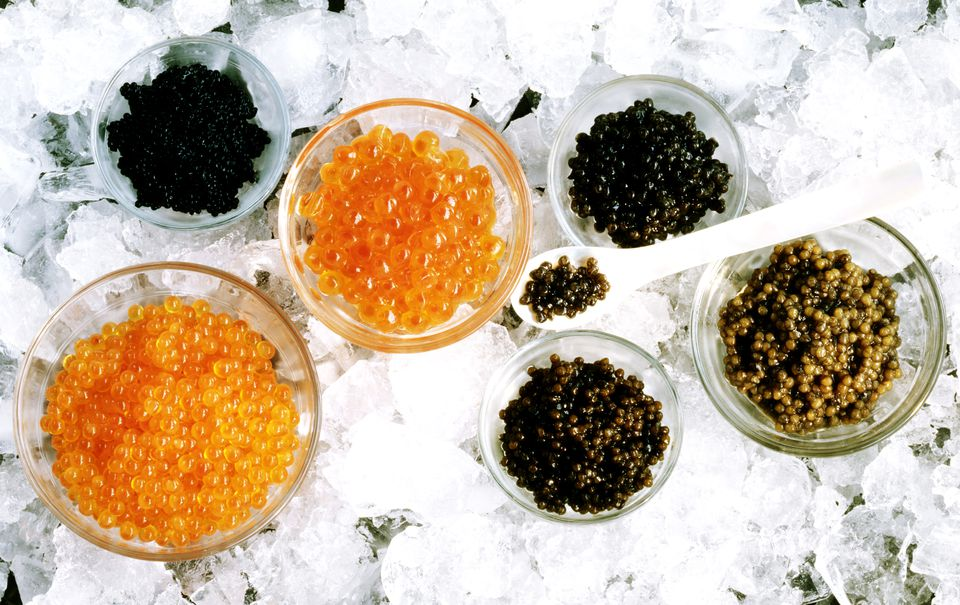 Bowls of caviar and roe on crushed ice