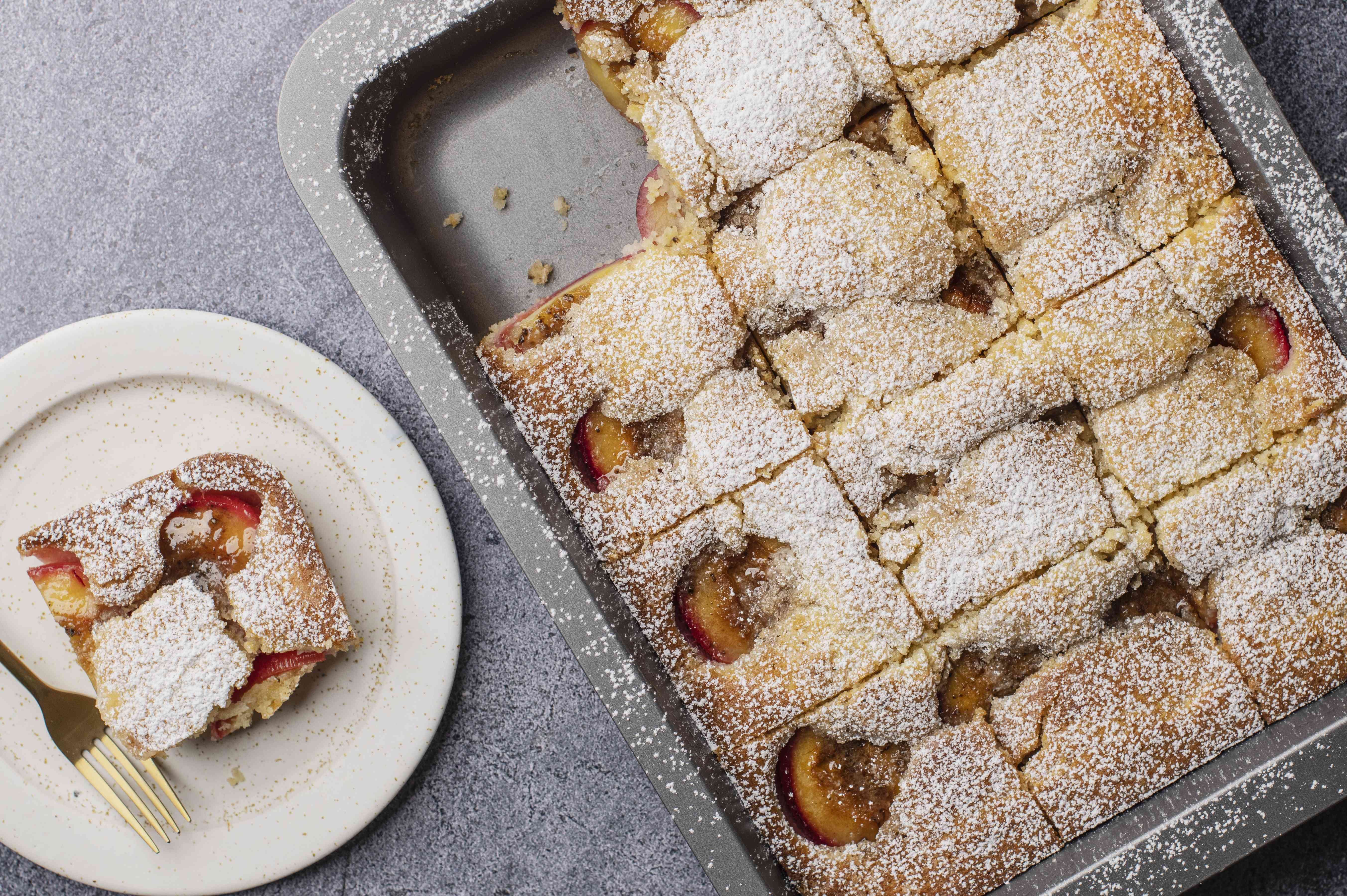 Polish plum cake dusted with powdered sugar and cut into 12 squares