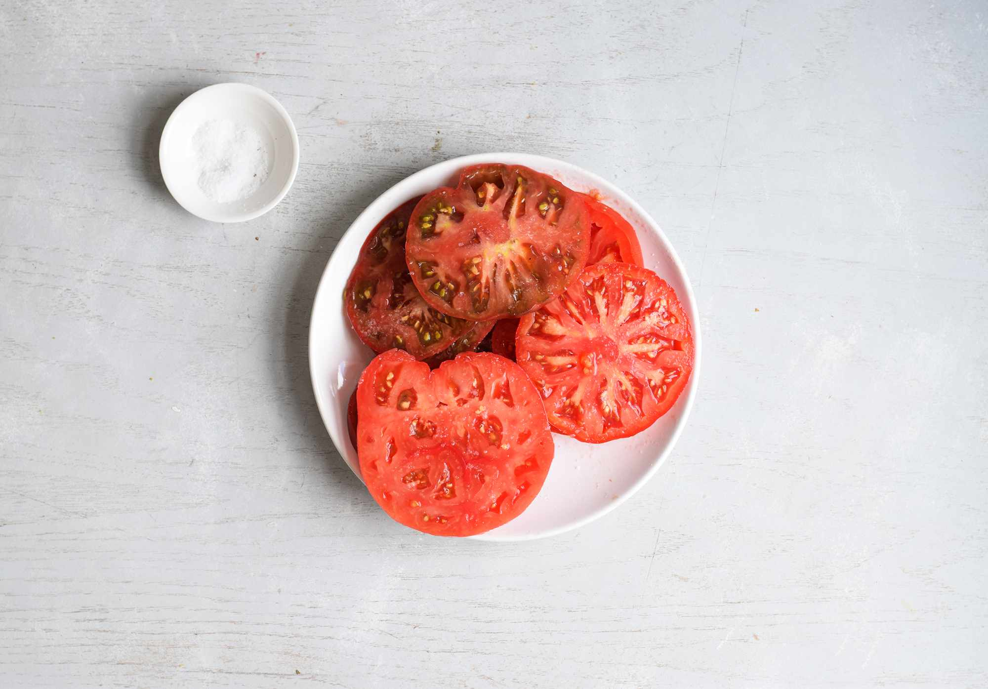 salted tomatoes on a plate